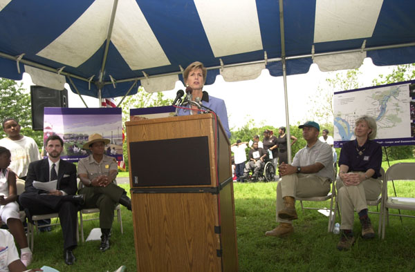 Environmental Protection Agency Administrator Christine Todd Whitman speaking at groundbreaking event for the first phase of the Anacostia Riverwalk Trail, a public-private partnership project involving Washington, D.C. government, the National Park Service, D.C. citizens groups, and environmental groups