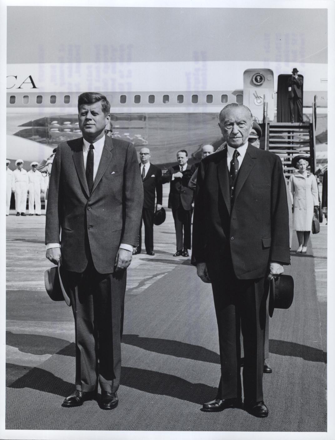 President Kennedy And Chancellor Adenauer Stand At Attention During The Playing of the U.S. and German National Anthems Immediately After The President's Arrival At Wahn Airport Today