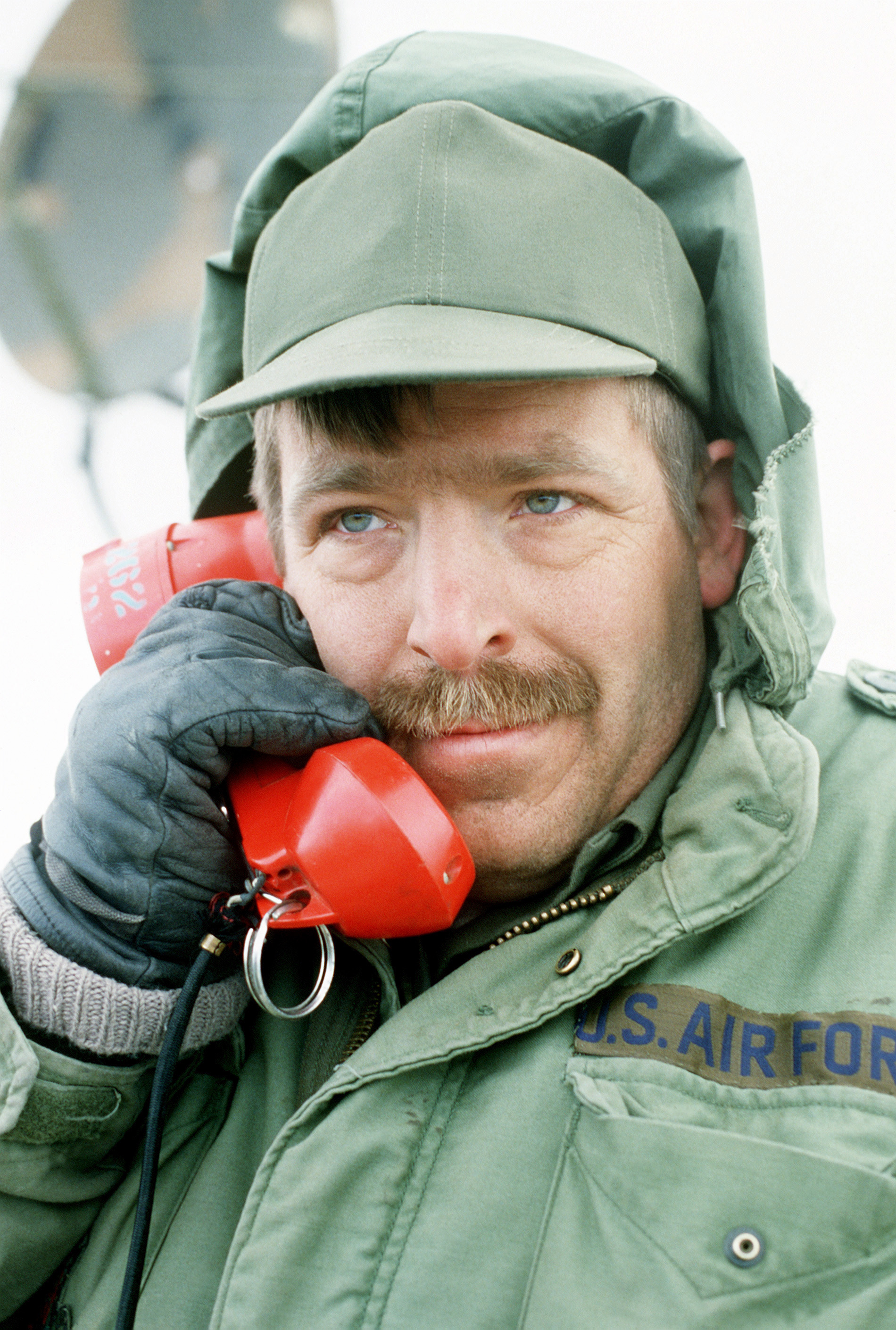 TSGT Gary Koch, a communications technician, checks a land line telephone to make sure it is in working order during Exercise Gallant Eagle '82