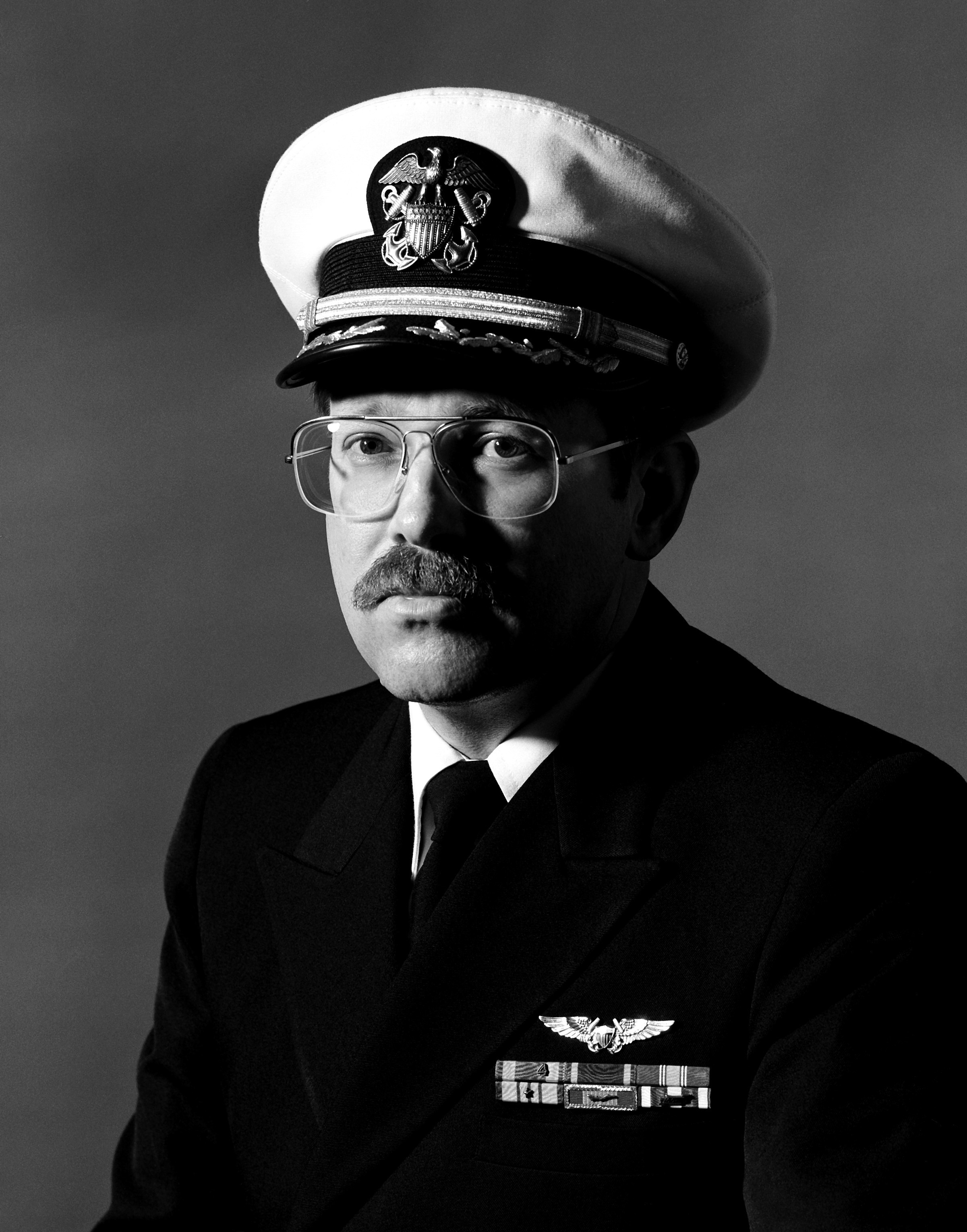 CDR Danie A. Woxland, USN (covered)