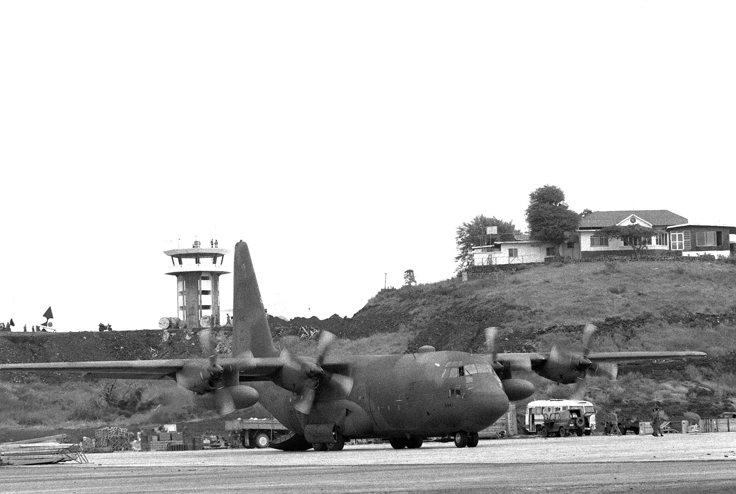 A C-130 Hercules aircraft on the flight line at Point Salines Airfield during the multiservice, multinational Operation URGENT FURY