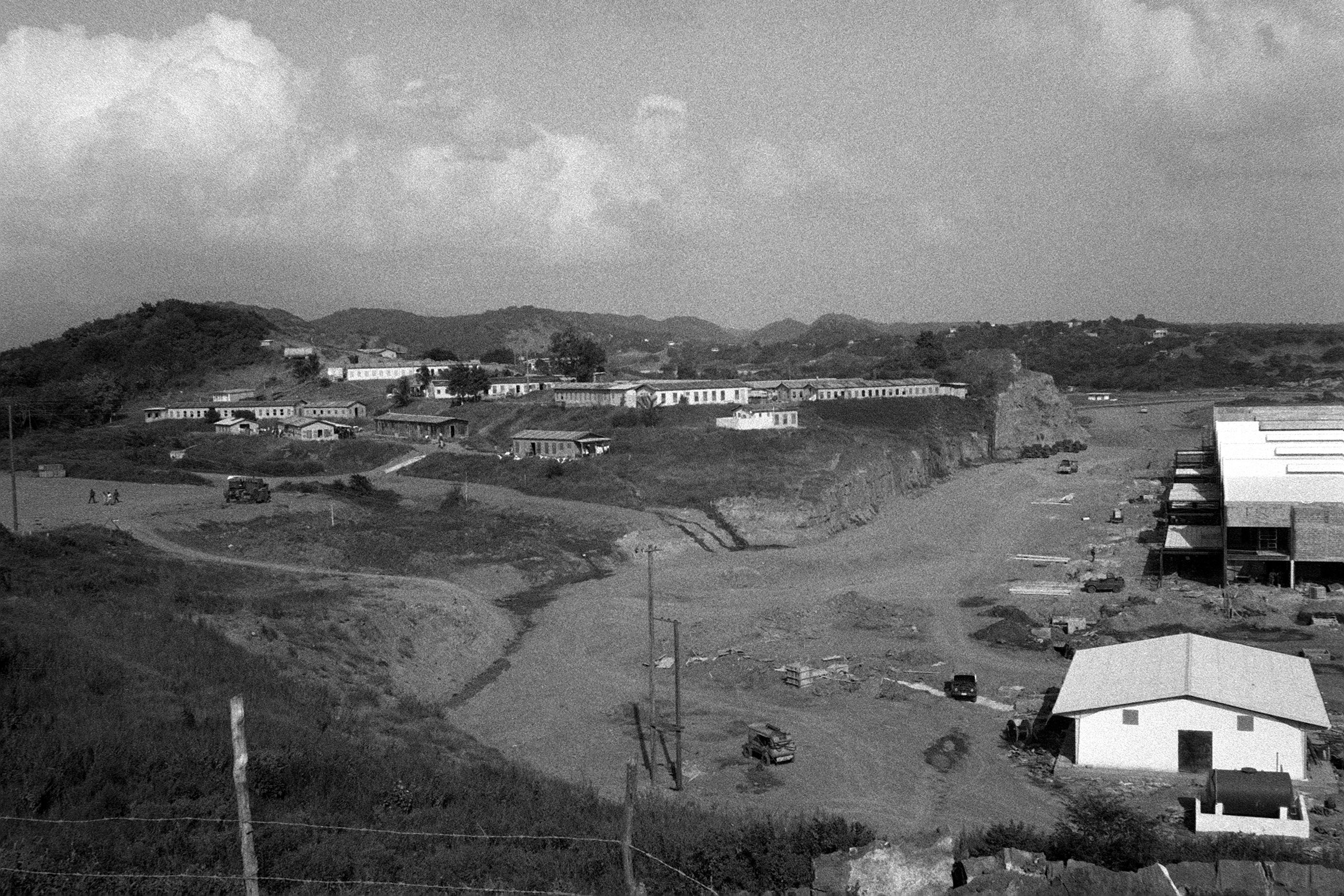 Buildings on a hill overlooking Point Salines Airfield during the multiservice, multinational Operation URGENT FURY