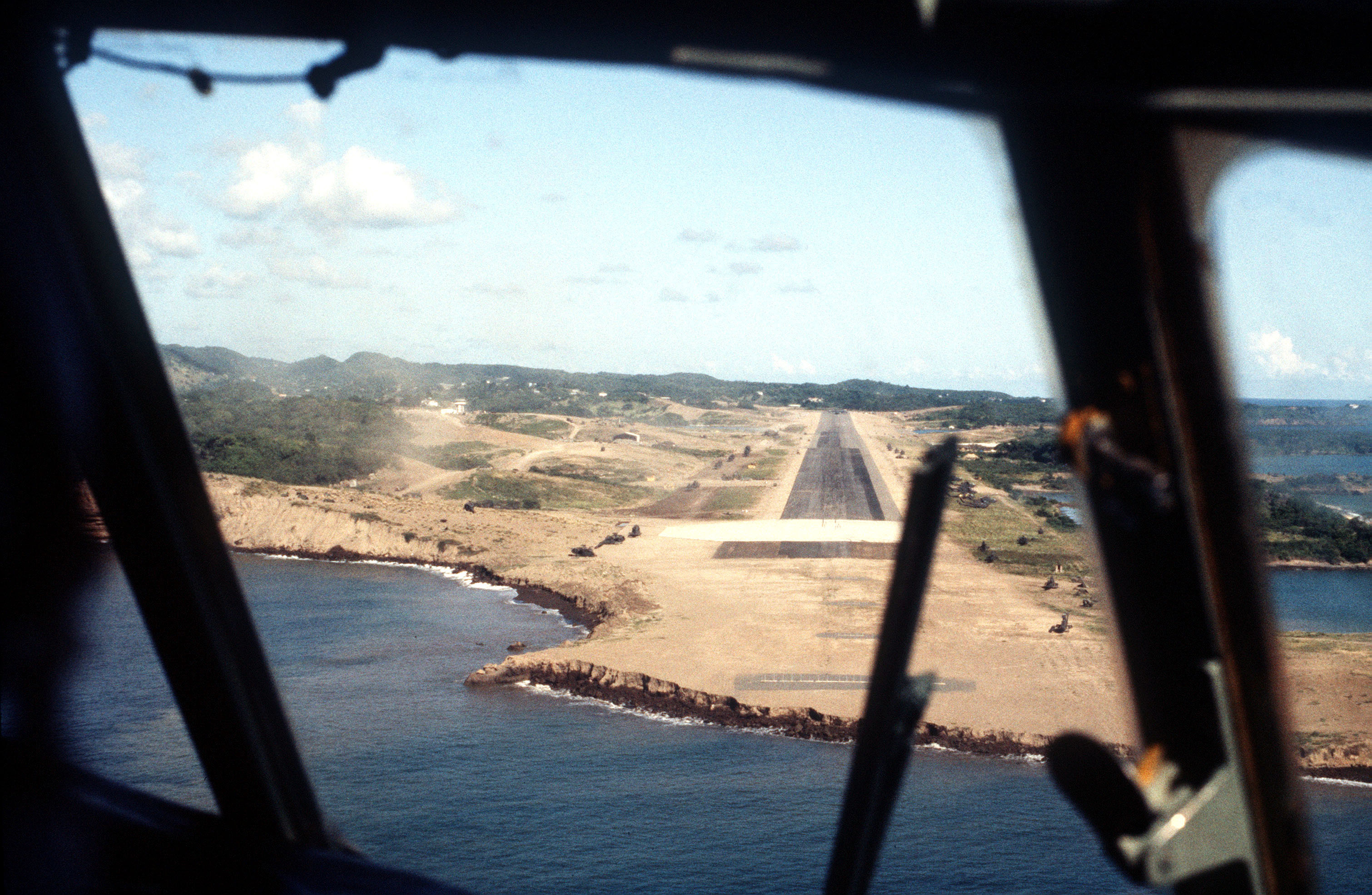 An aerial view of Point Salines, as seen from an aircraft approaching the runway during Operation URGENT FURY