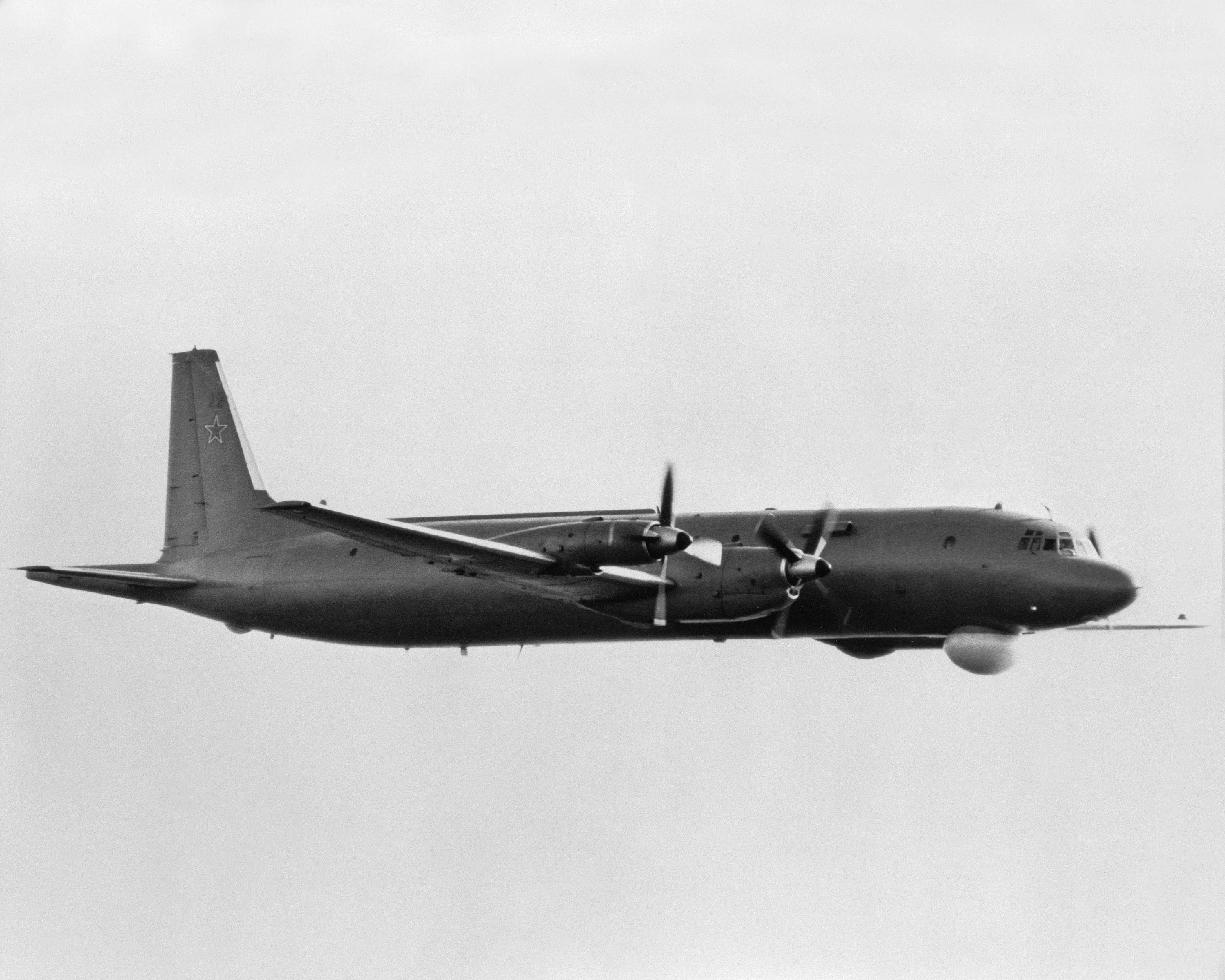 An air-to-air right side view of a Soviet I1-38 May anti-submarine warfare aircraft