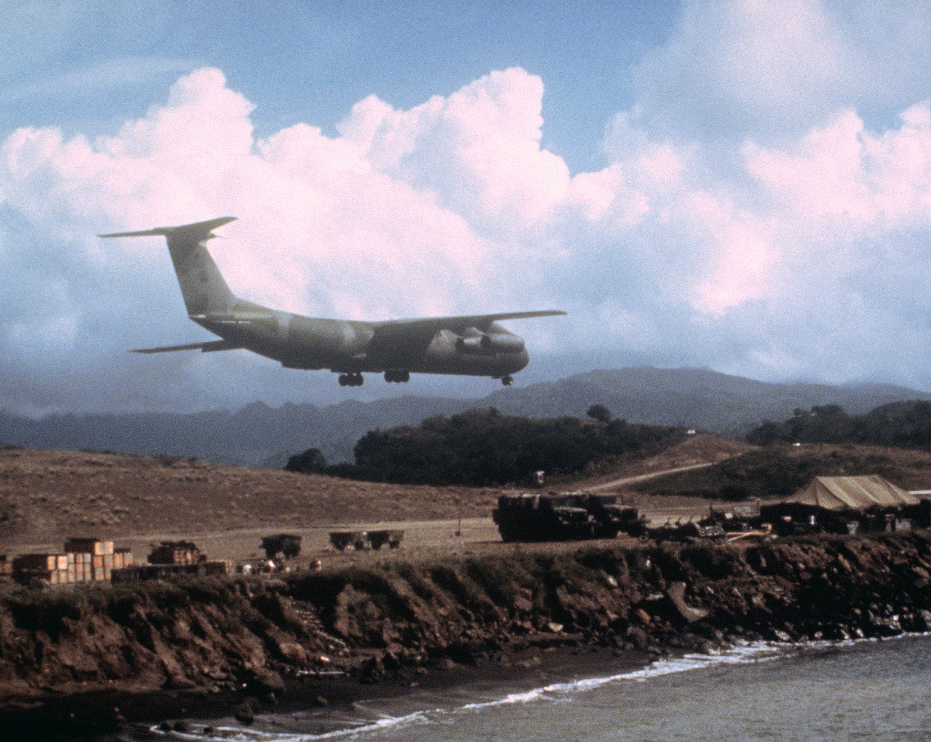 A C-141B Starlifter aircraft lands at Point Salines Airport during Operation URGENT FURY