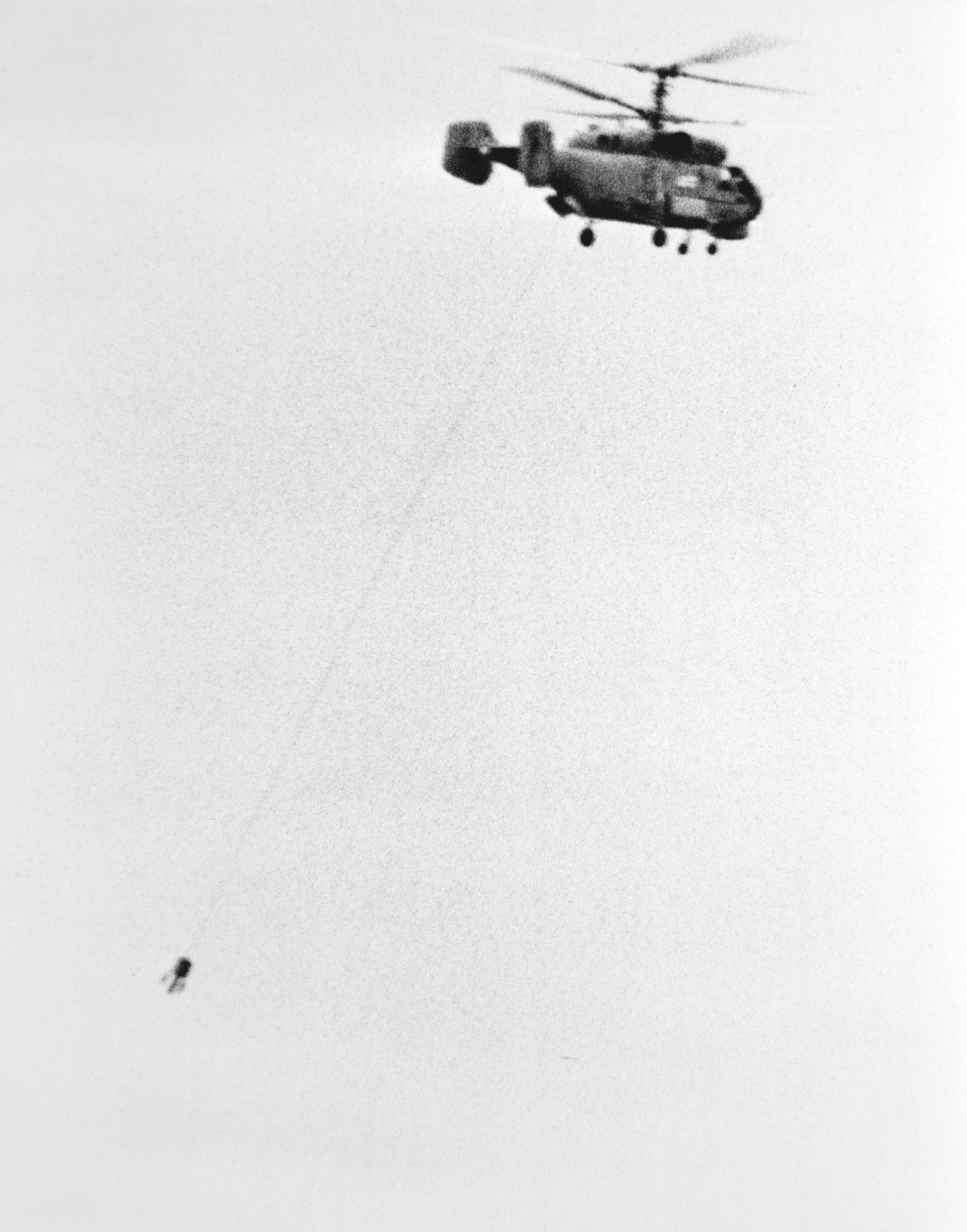 A Soviet Ka-27 Helix-A anti-submarine warfare helicopter in flight with dipping sonar deployed