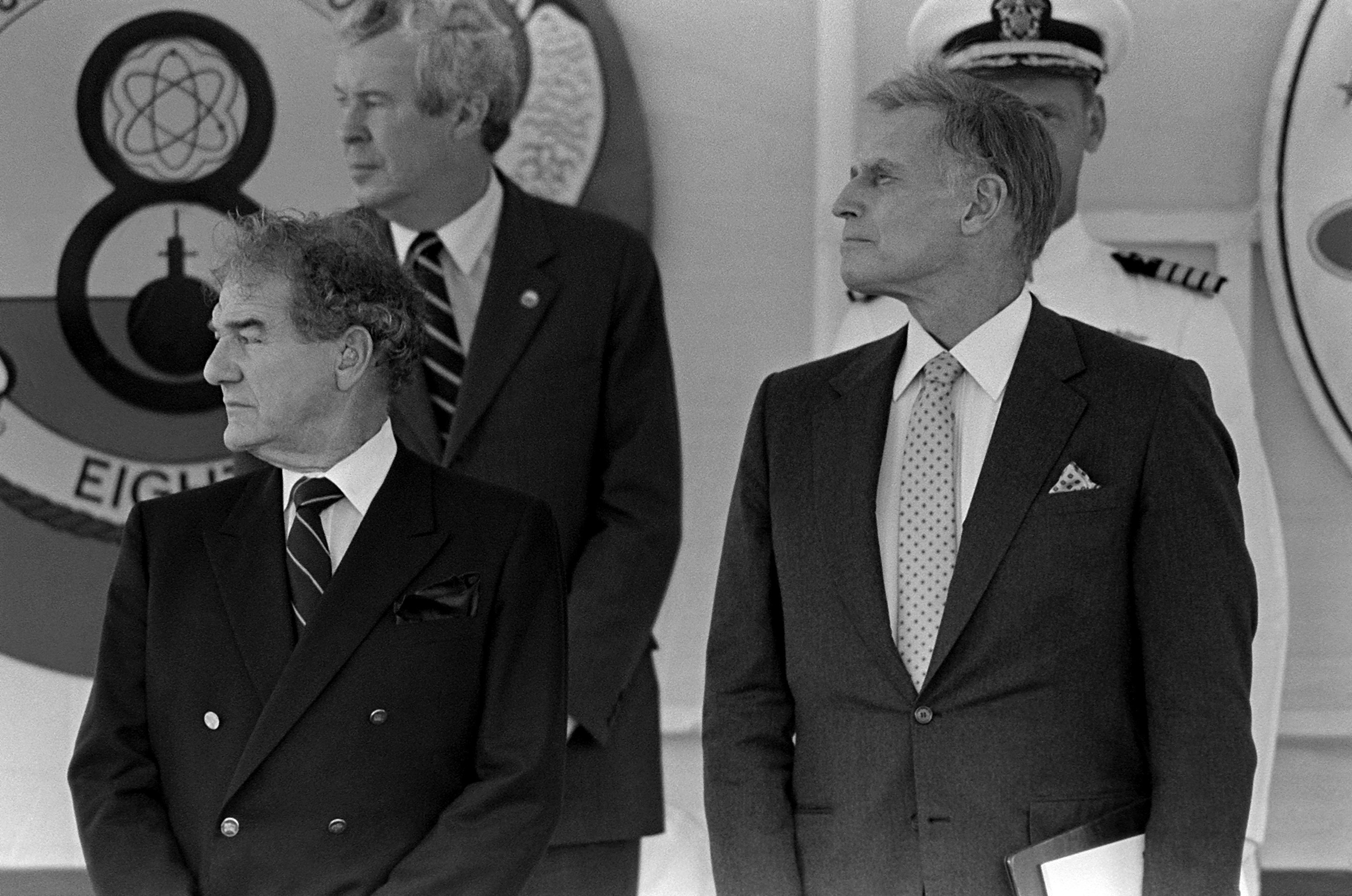 Actor Charlton Heston, principal speaker, right, and Assistant Secretary of the Navy for Research, Engineering and Systems Melvyn R. Paisley attend the commissioning of the nuclear-powered attack submarine USS CHICAGO (SSN 721)