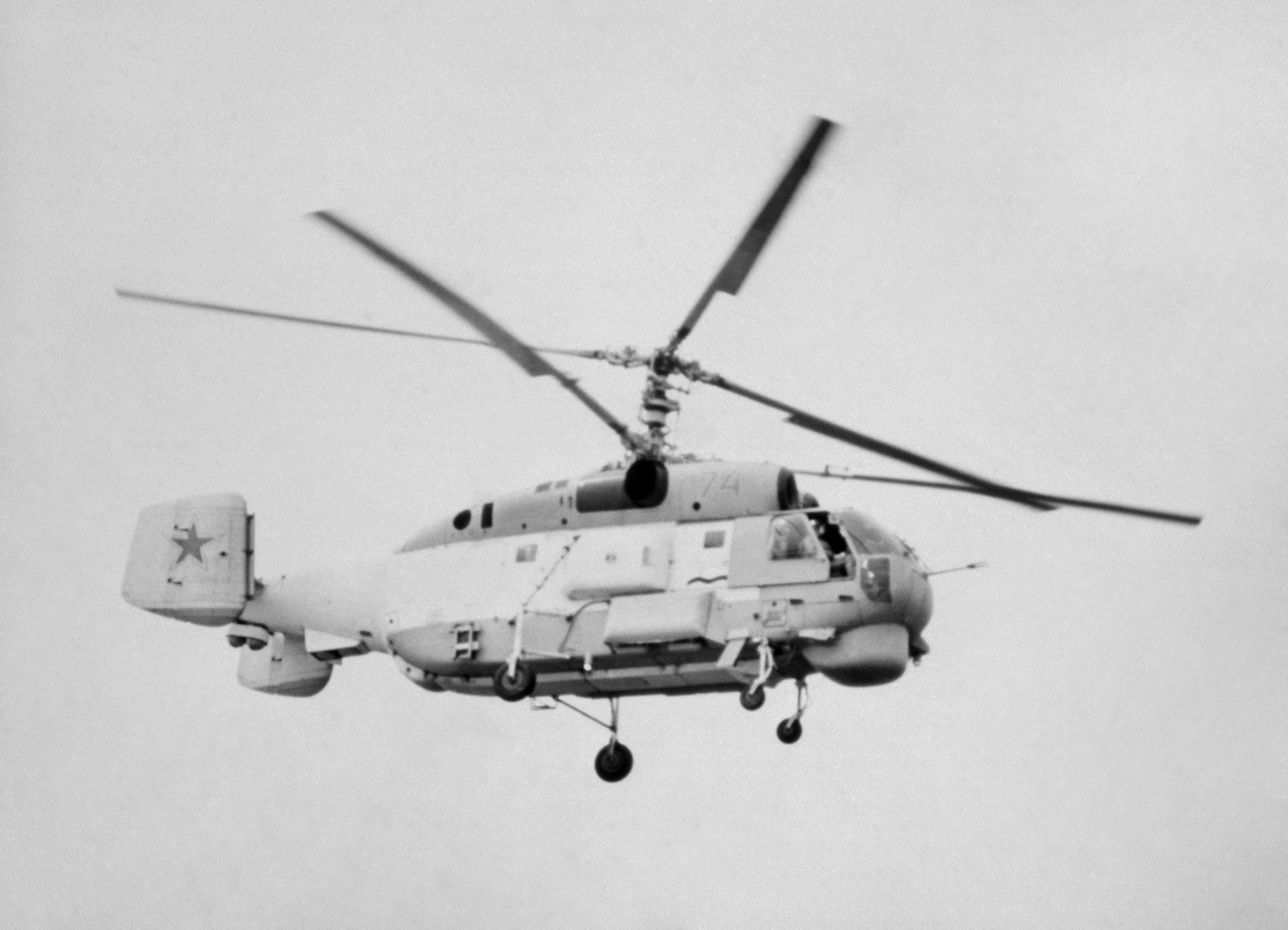 A right side view of a Soviet Ka-27 Helix anti-submarine warfare helicopter in flight