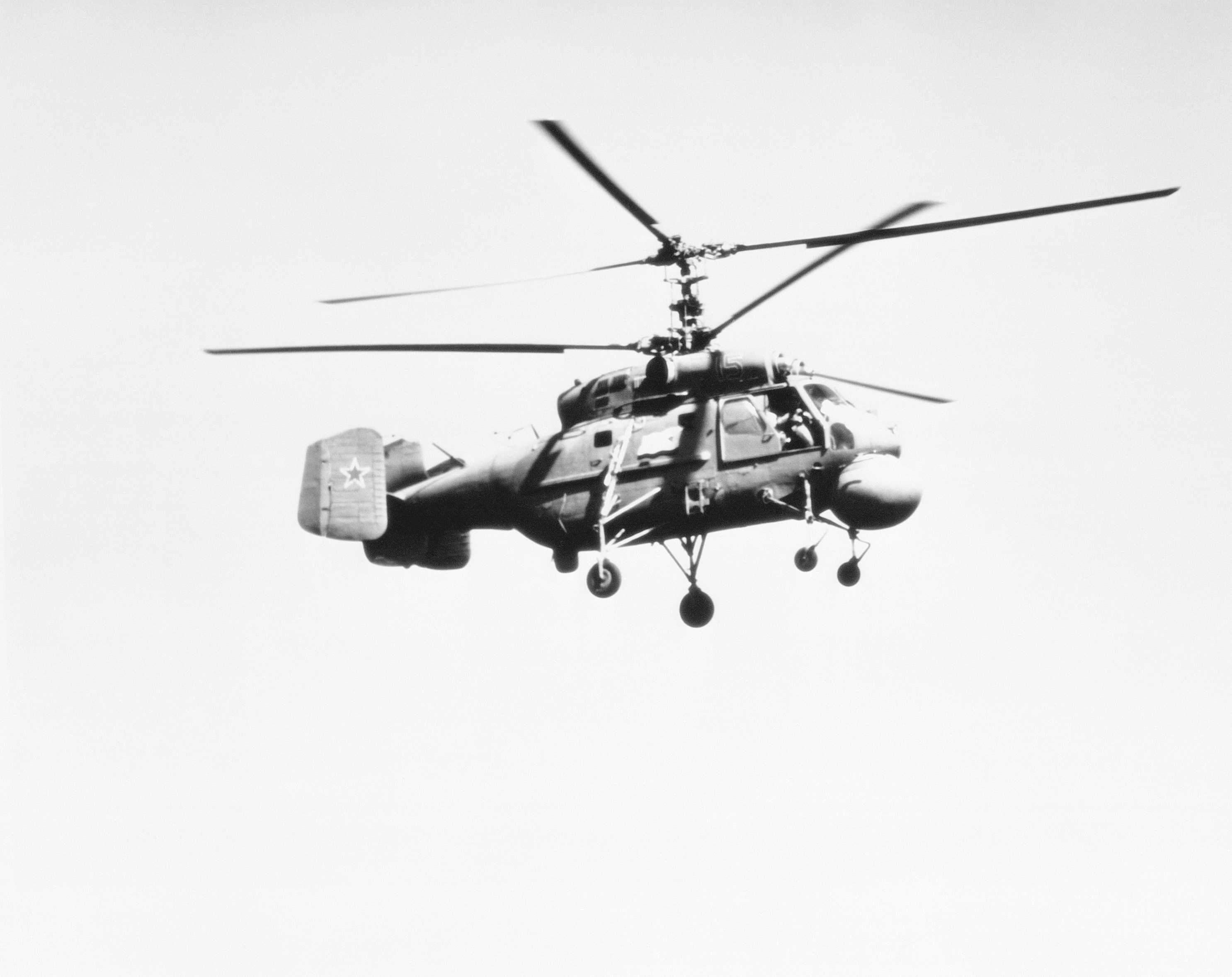 A right side view of a Soviet Ka-25 Hormone B anti-submarine warfare helicopter in flight