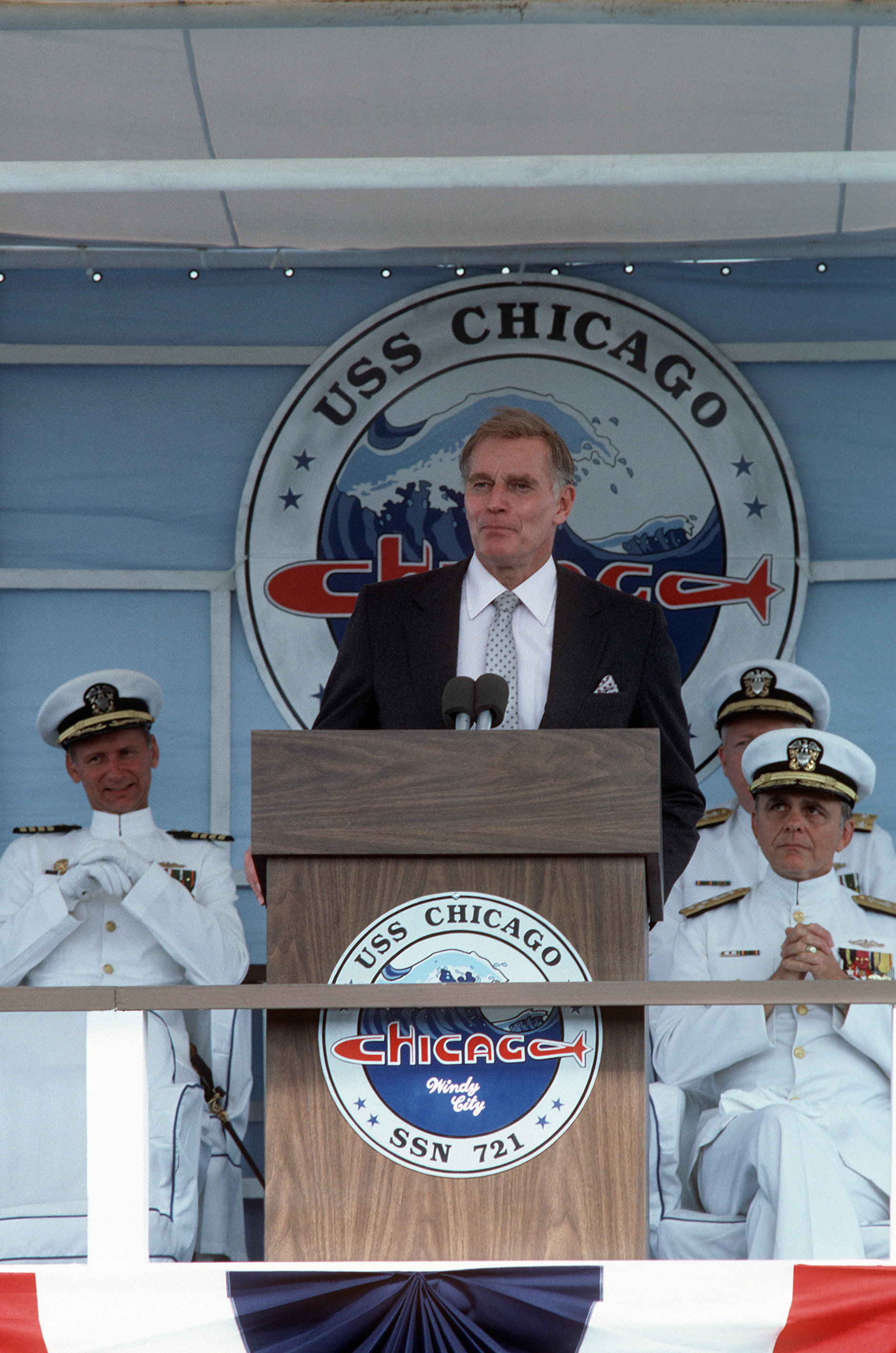 Actor Charlton Heston delivers the principal address during the commissioning of the nuclear-powered attack submarine USS CHICAGO (SSN 721)