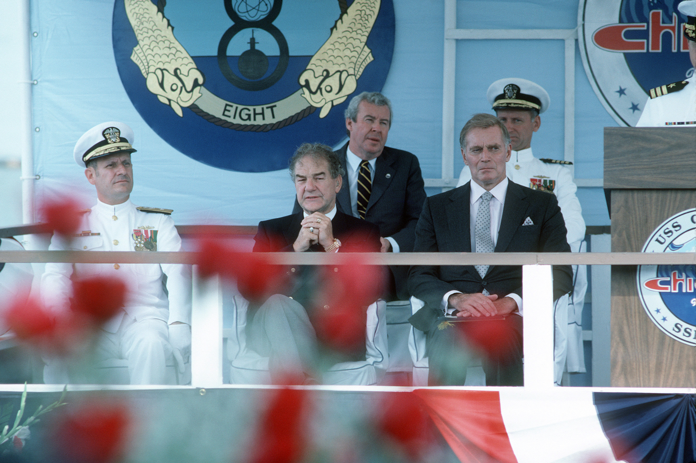 Actor Charlton Heston, right, Assistant Secretary Melvyn R. Paisley, center, and Rear Admiral Stanley E. Bump, commander, Submarine Group Six, attend the commissioning of the nuclear-powered attack submarine USS CHICAGO (SSN 721)