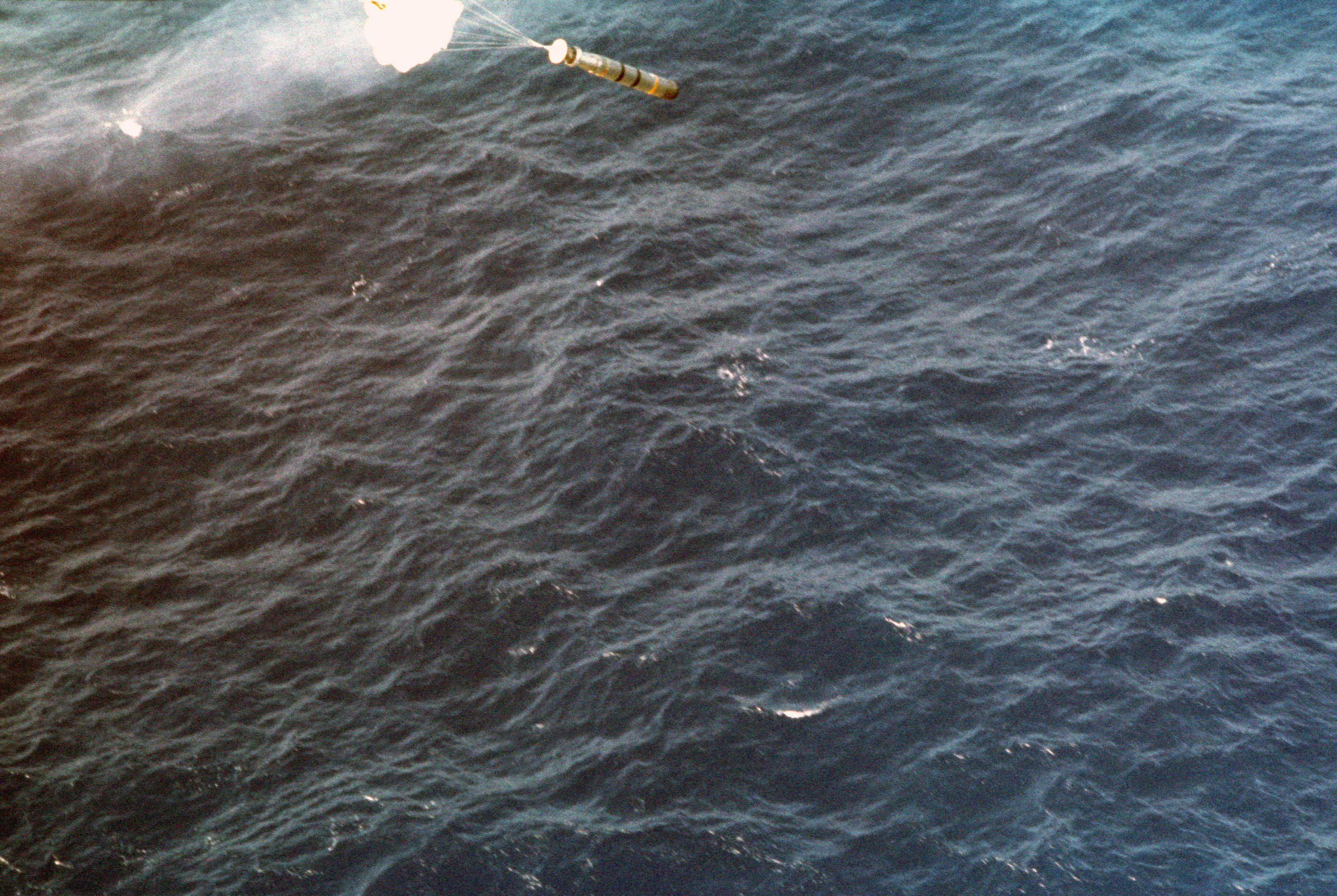 A Mark 46 torpedo is released from an SH-3 Sea King helicopter conducting an anti-submarine warfare exercise