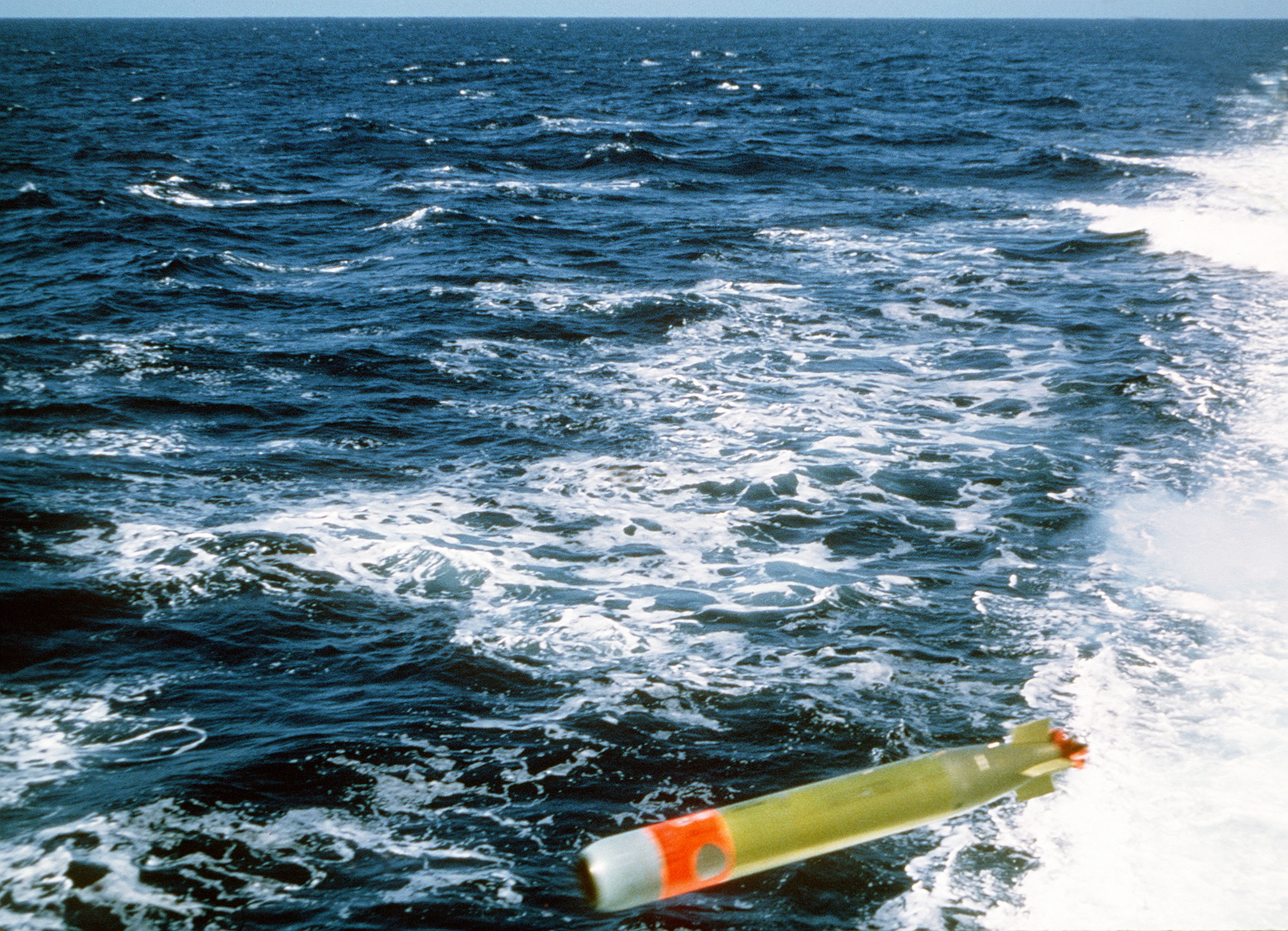 A Mark 46 torpedo is launched from the destroyer USS STUMP (DD-978) during anti-submarine warfare exercises