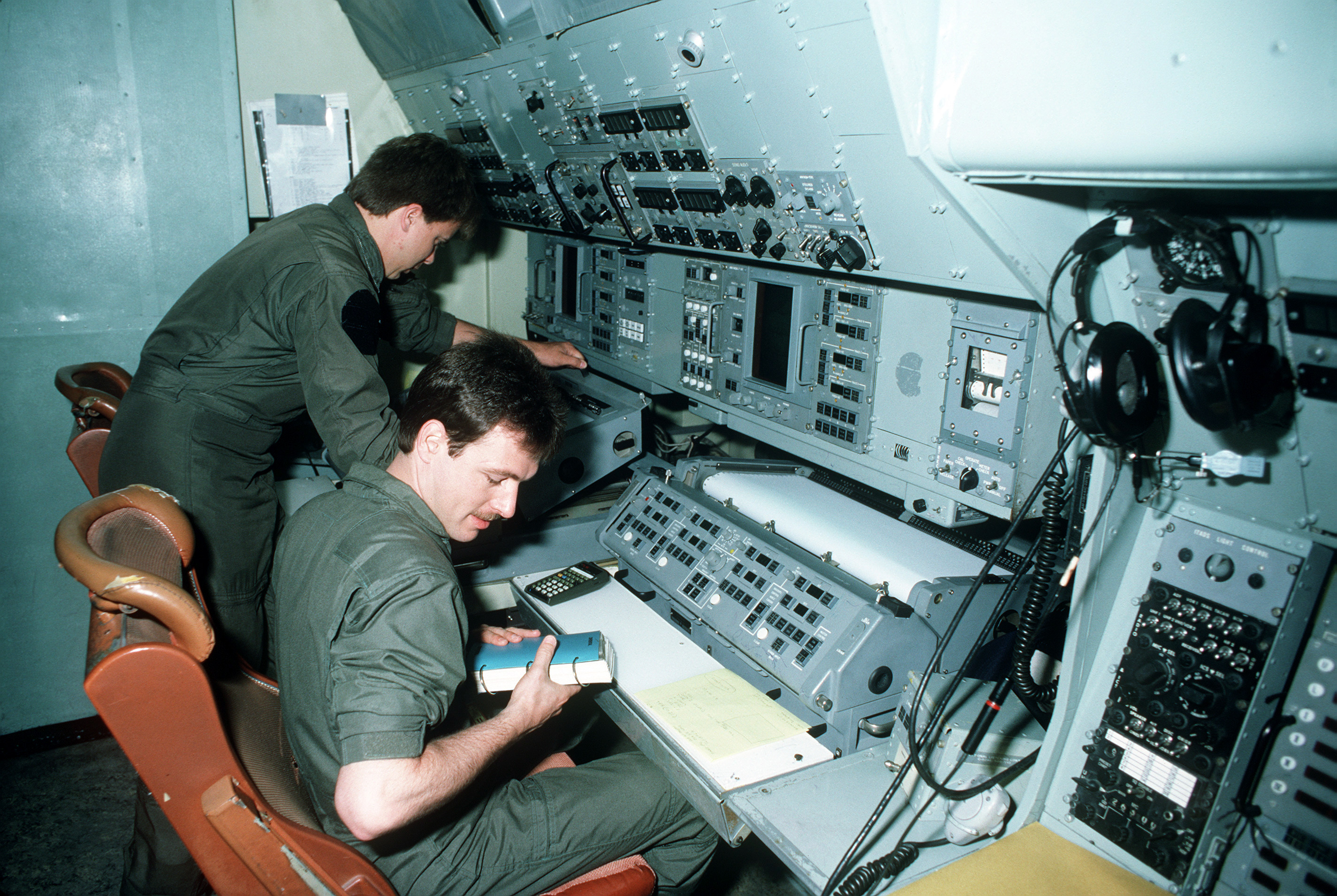 Aviation anti-submarine warfare operators prepare to qualify as accoustic operators in the P-3 Orion weapons system trainer (WST)