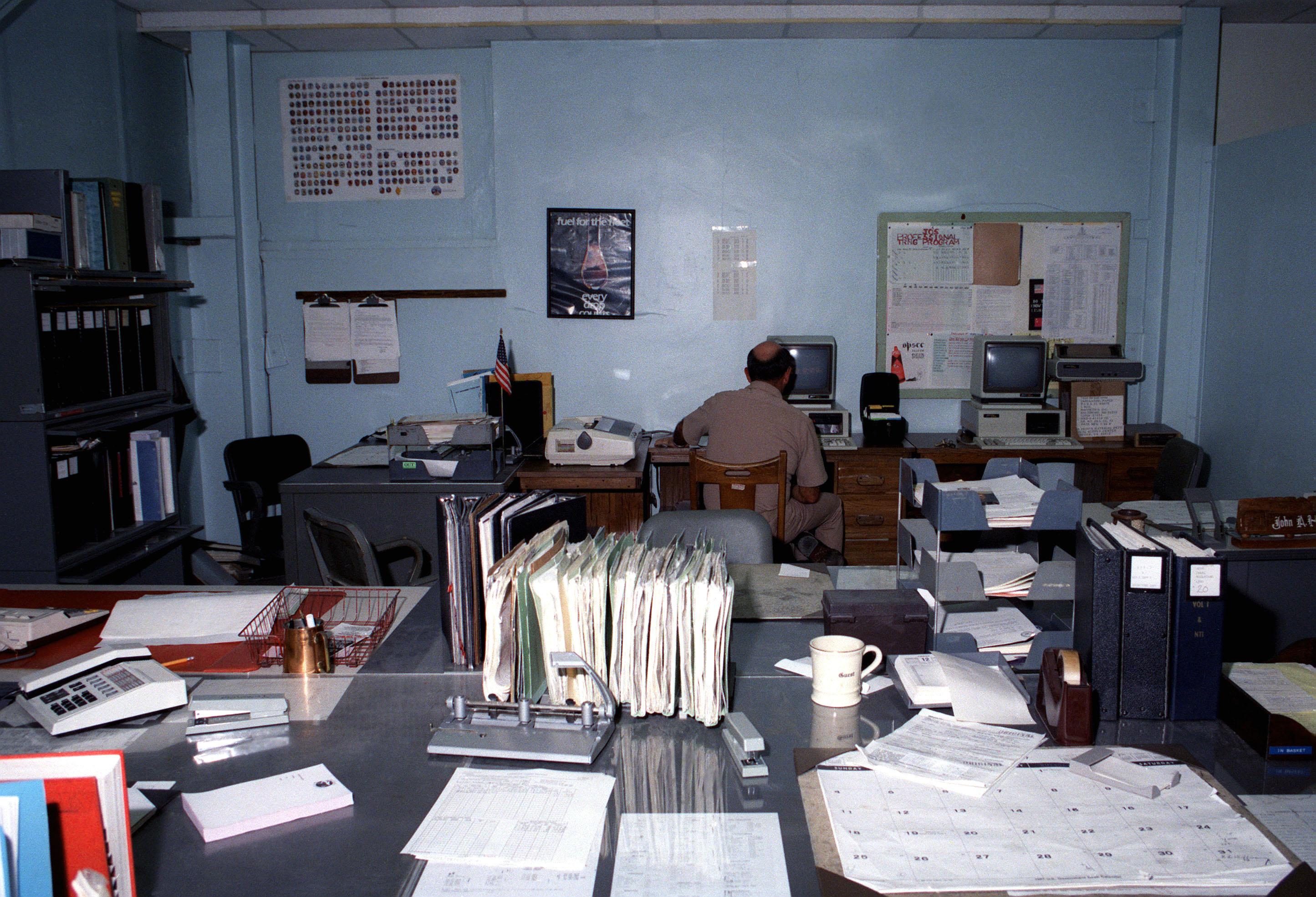 SENIOR CHIEF Aviation Anti-submarine Warfare Technician Elkins uses a computer in the Patrol Squadron 10 (VP-10) material control office