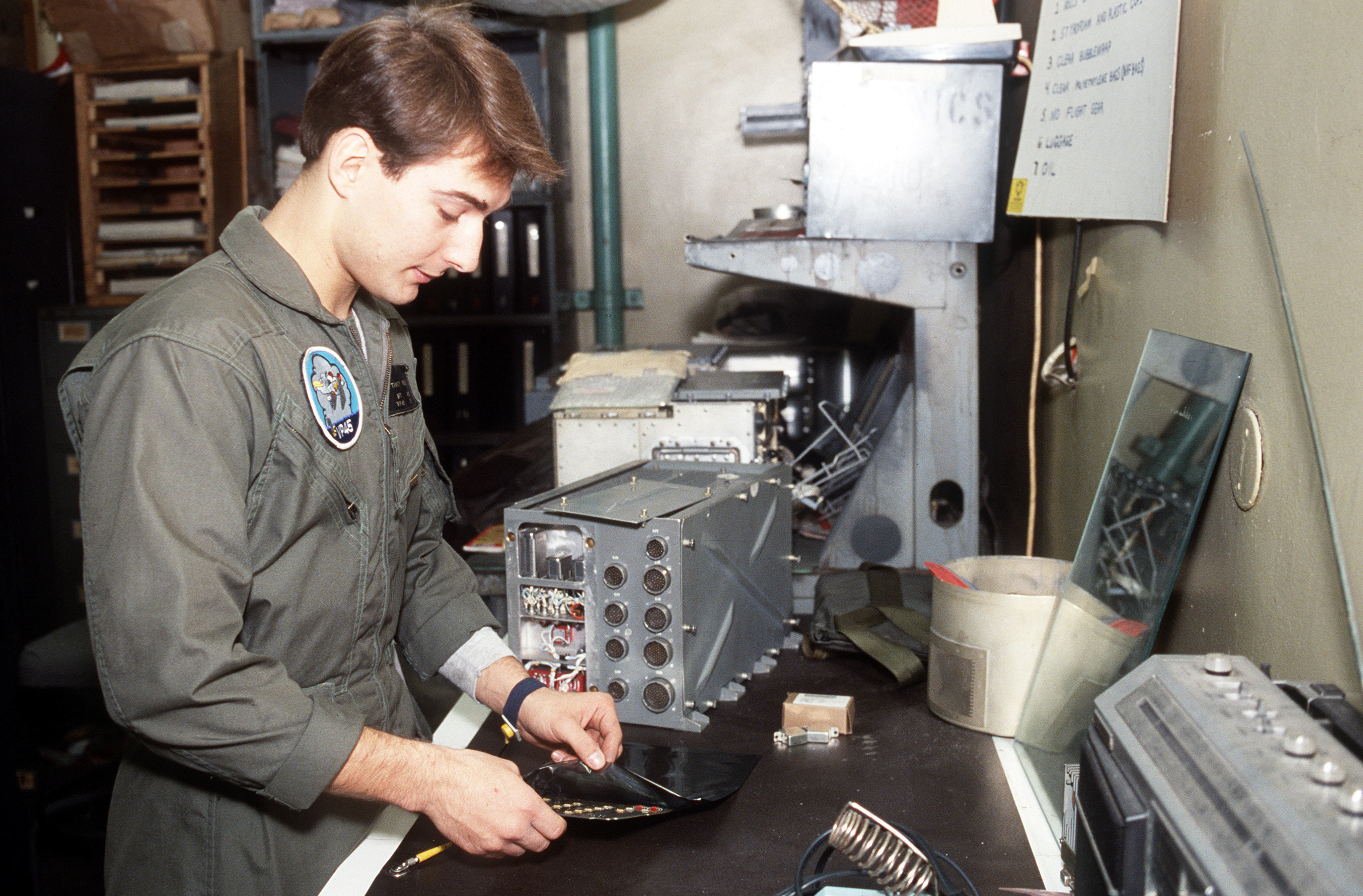 Anti-submarine Warfare Technician 3rd Class Timothy A. Veres, Patrol Squadron 45 (VP-45), packages a damaged circuit for shipment