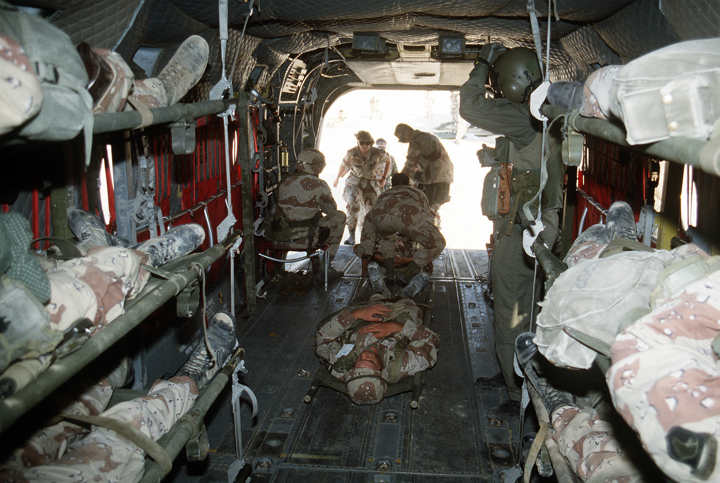 Simulated casualties are placed on a C-130 Hercules aircraft after receiving medical care at treatment tents as part of a mock casualty exercise taking place during Operation Desert Shield