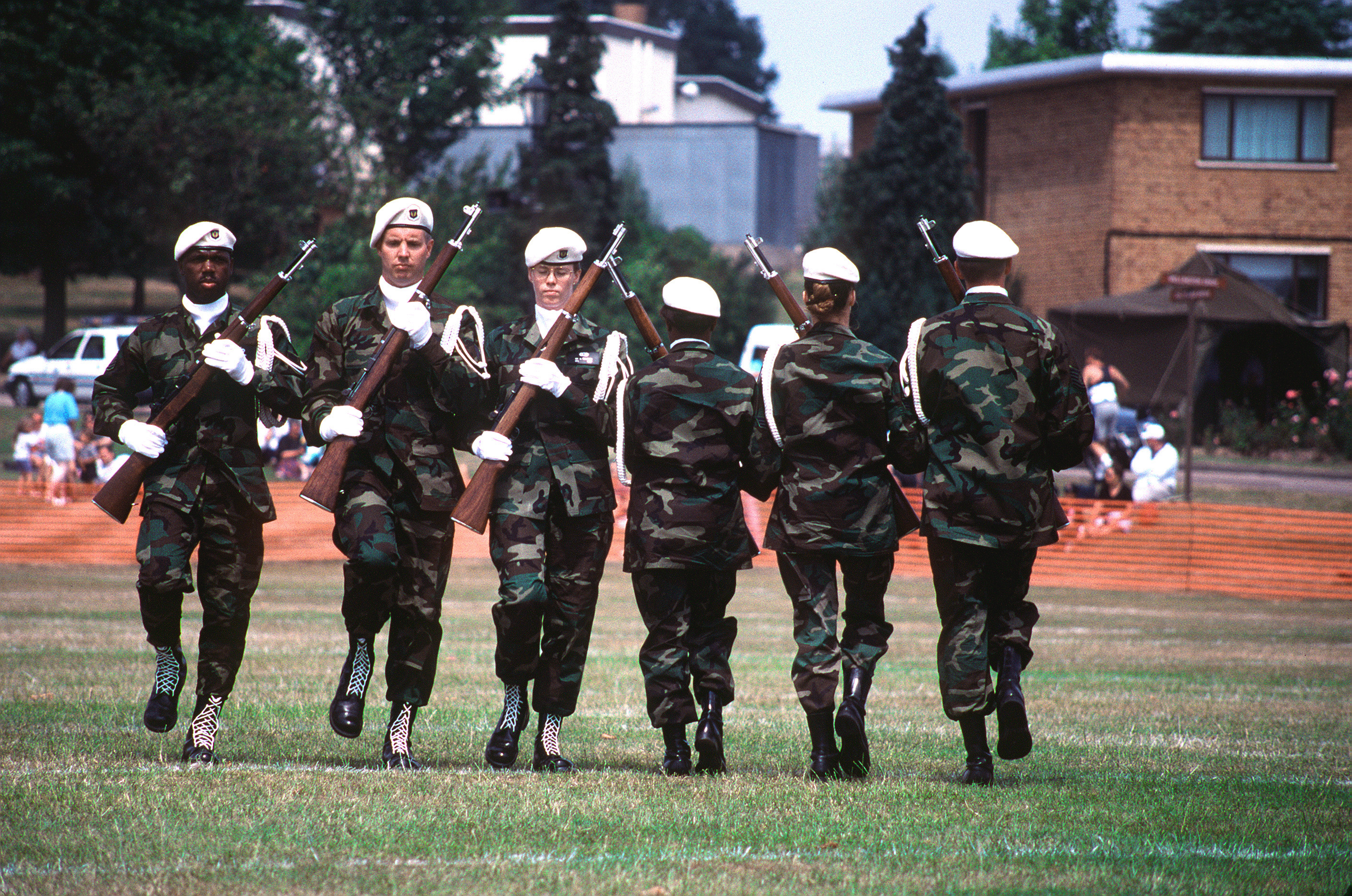 The RAF Chicksand's drill team performs precision drill movements for the spectators. RAF Chicksands hosts the most extravagant open house to date called the