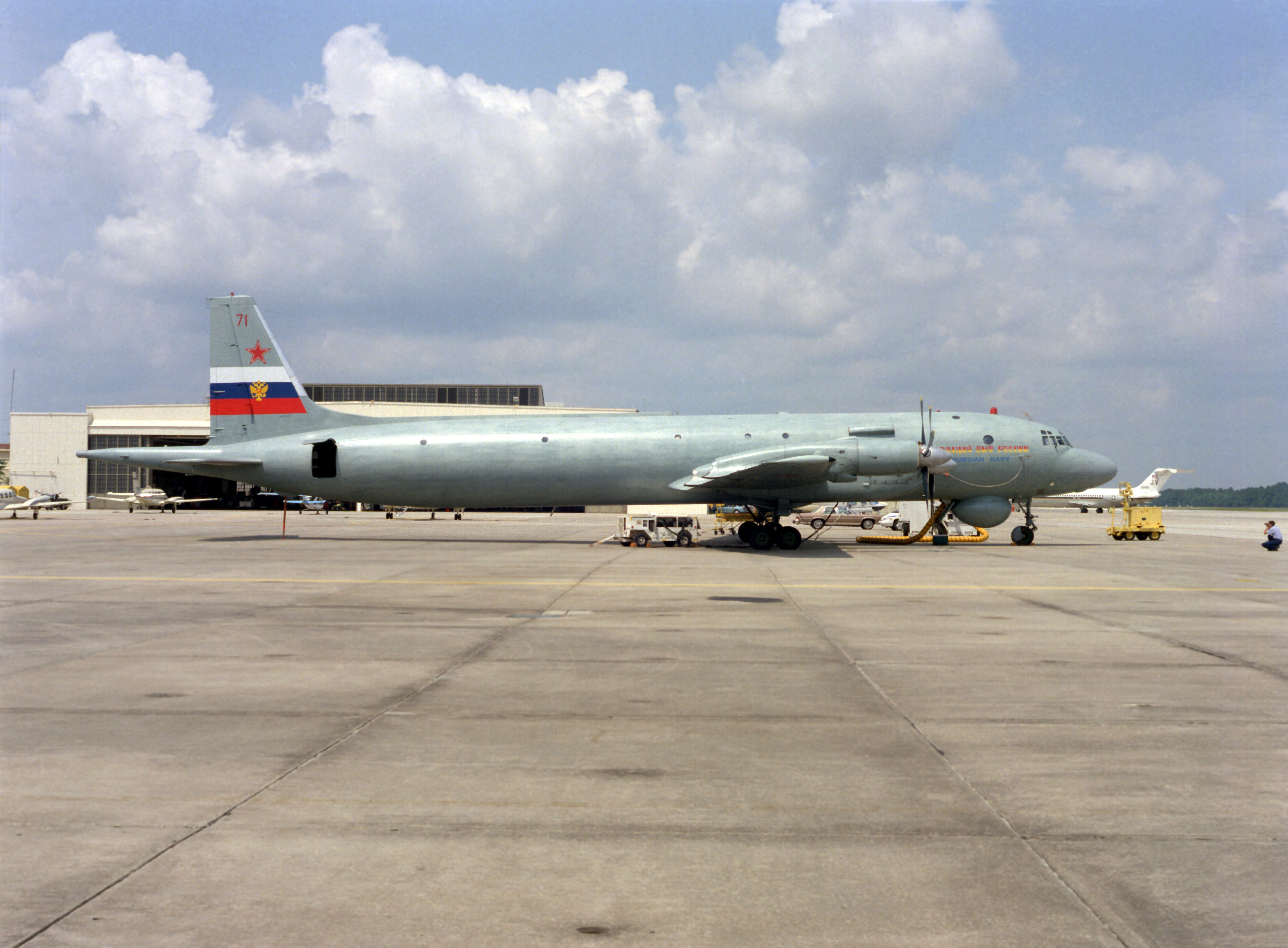 Right side view of a Russian IL-38 May anti-submarine warfare (ASW) patrol aircraft parked on the tarmac