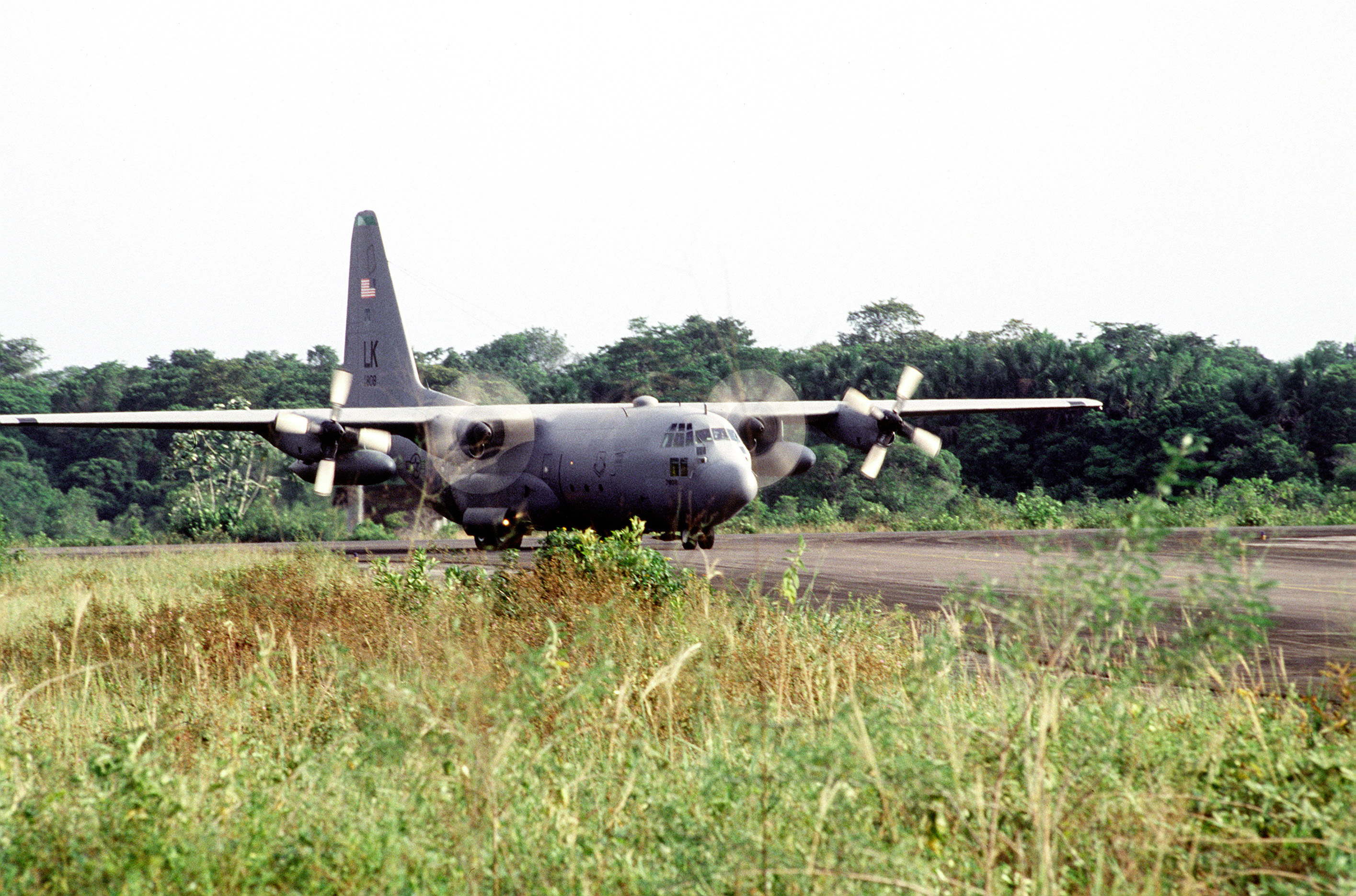 A C-130 Hercules of the 61st Airlift Squadron, Little Rock Air Force Base, Ark., taxis on the flightline of the Johan Adolf Penger Airport carrying supplies and personnel.(Exact date unknown)