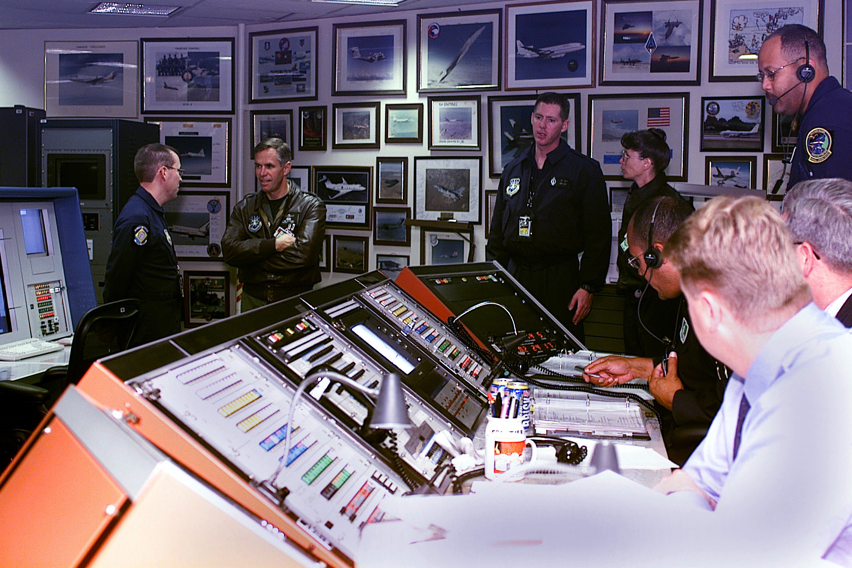 Members of the 30th Range Squadron, Vandenberg Air Force Base, California, brief US Air Force Brigadier General Gary R. Dylewski on an upcoming Minuteman III Launch. The Airspace and Offshore Management flight team showed BGEN Dylewski how they ensure that aircraft, trains and other offshore vehicles are at a safe distance before approving a launch