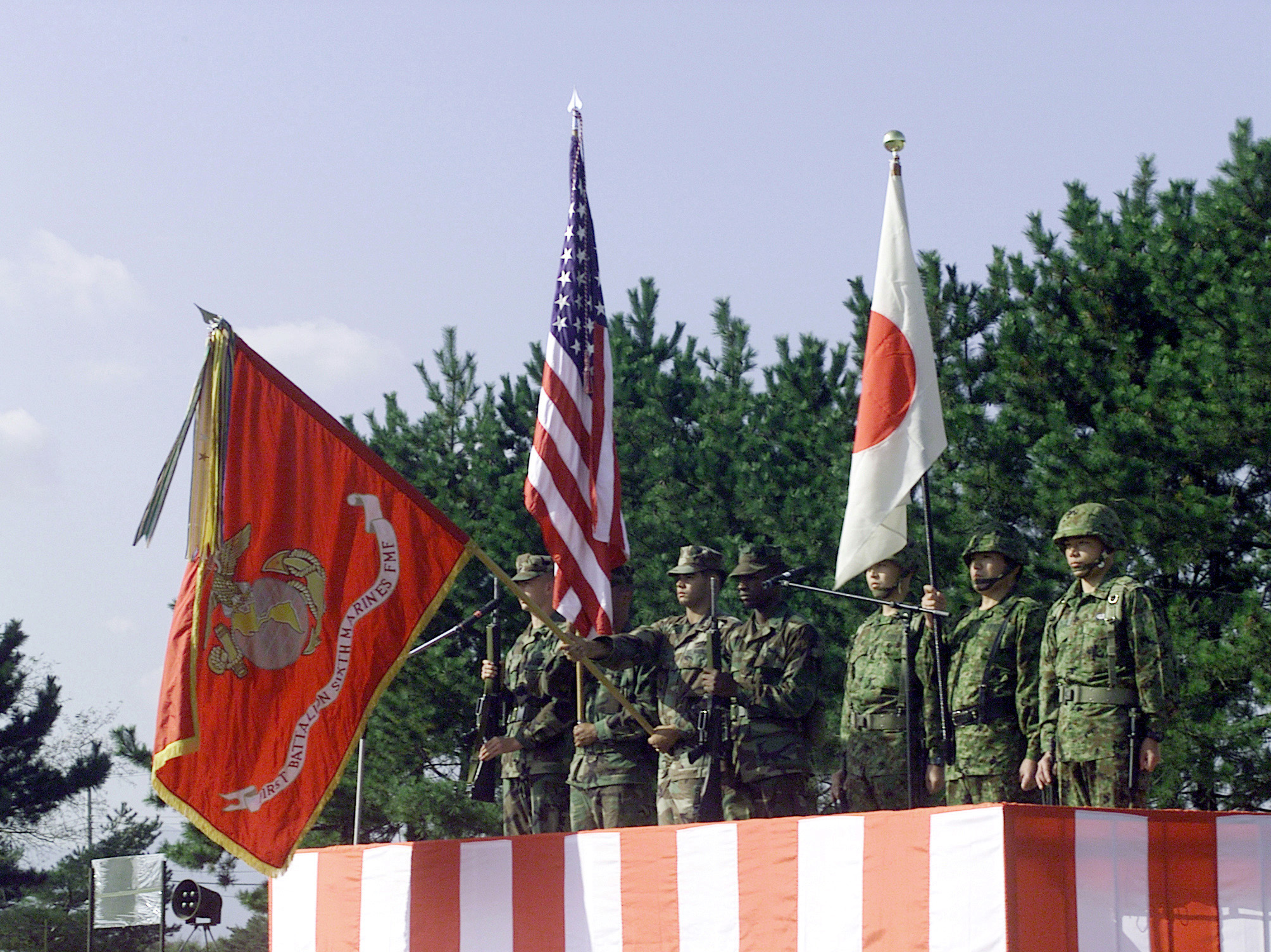 Both the Marine and Japanese Color Guard stand tall, rendering proper respect for both National Anthems at the Opening Ceremony during Forest Light 2000. Forest Light is a cultural enhancing, combined arms exercise in which Marines from 1ST Battalion, 6th Marine Regiment train with soldiers from the 44th Infantry Regiment, Japanese Ground Self Defense Force (JGSDF). The units train side by side teaching each other various weapons systems, different tactical offenses and defenses, as well as close combat skills