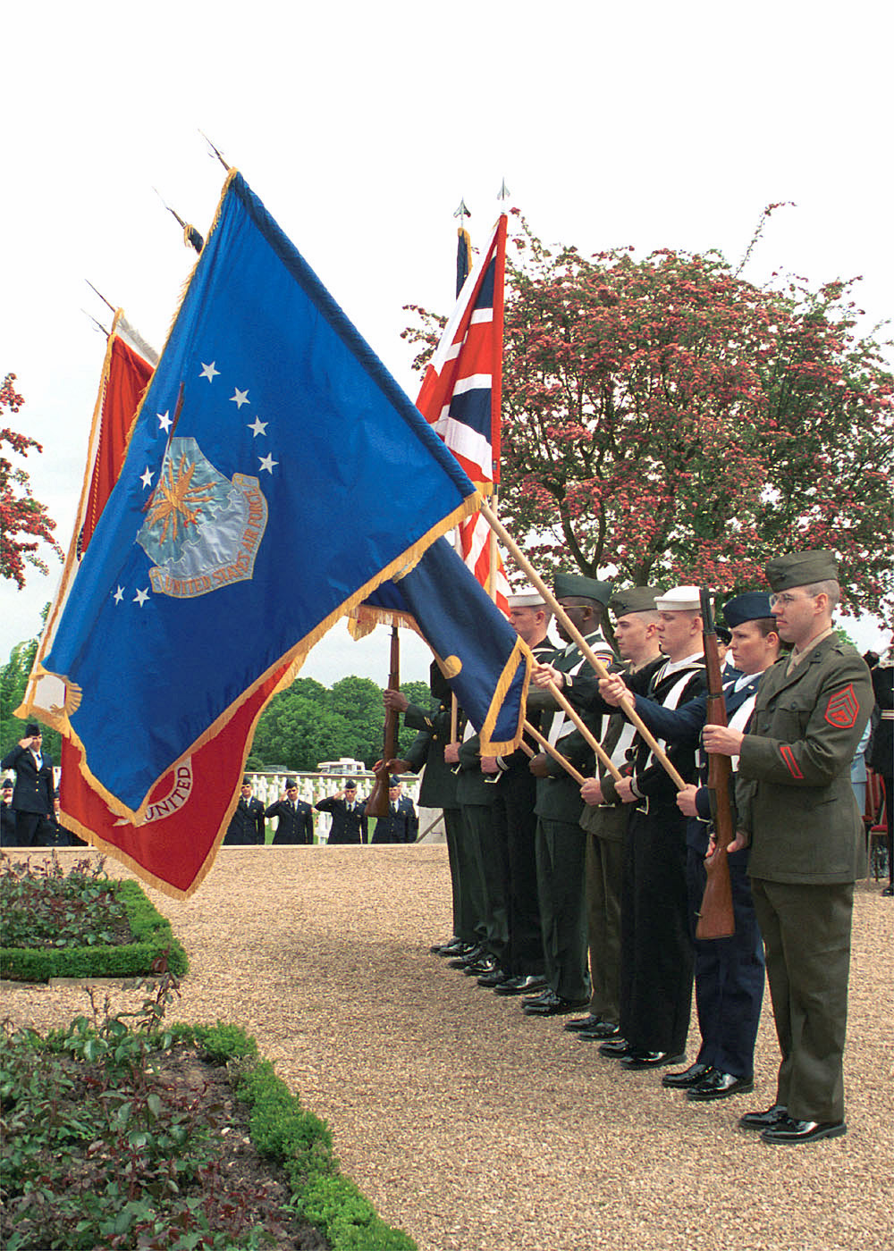 Color Guard Posts the Colors, while the US Air Forces in Europe Band plays the British and American National Anthems during the Madingley Memorial Day Commemorative Service. The ceremony was held at Cambridge American Military Cemetery, Coton, Cambridge, United Kingdom