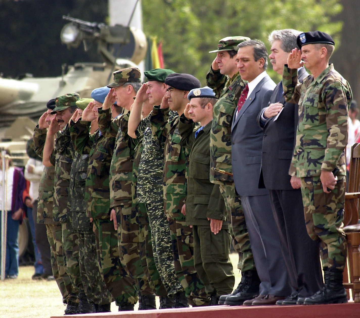 Military and civilian leaders stand during the playing of the national anthems of the nine nations that participated in CABANAS 2001. The multinational peacekeeping exercise took place in Salta, Argentina. This exercise is the largest joint and combined service exercise held in the region and it focuses on a variety of N.N. peacekeeping tasks including: tactical troop movement, food distribution, identification and marking of mines, civil-military, security and police operations