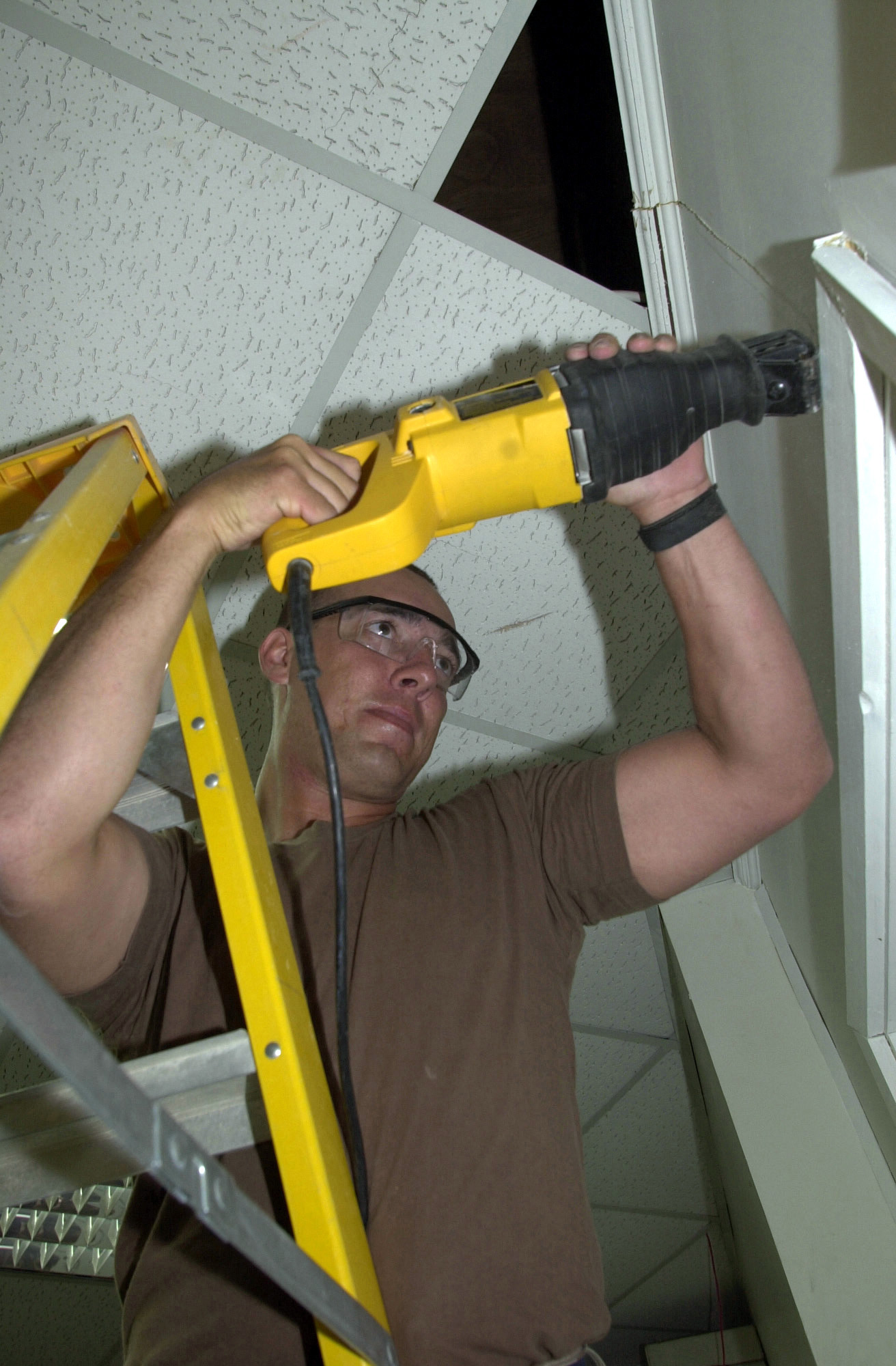 STAFF Sergeant (SSGT) Edward W. Davenport, an Air National Guard (ANG) member from Meridian, Mississippi, uses a jigsaw to cut through drywall at a renovated post office