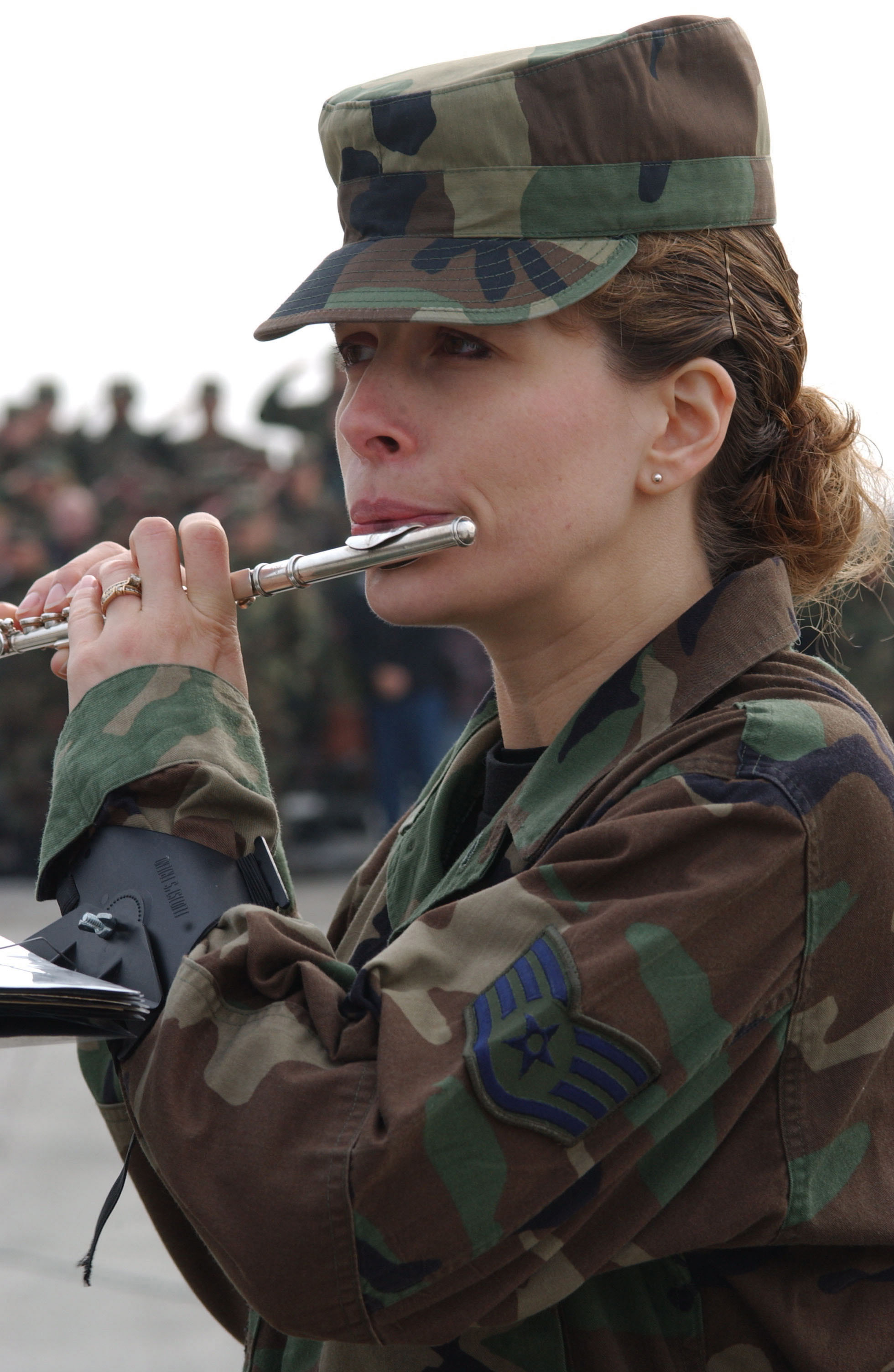 US Air Force (USAF) STAFF Sergeant (SSGT) Jennifer Harkins, a flutist with the US Air Forces in Europe (USAFE) Band, performs the National Anthems of Germany and the United States during the 86th Airlift Wing (AW) Transition Ceremony, at USAF Ramstein Air Base (AB), Germany