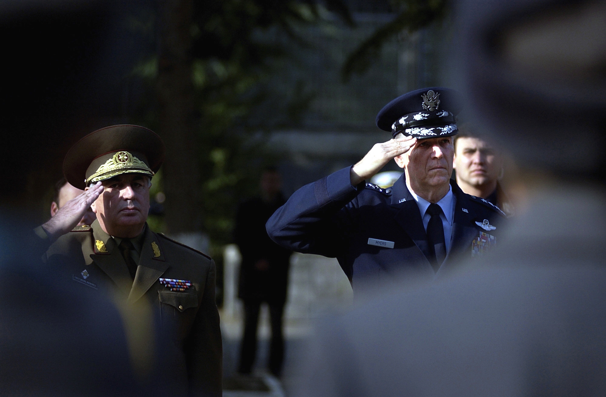 US Air Force (USAF) General (GEN) Richard B. Myers (right), Chairman of the Joint Chiefs of STAFF (JCS), and Georgian General Lieutenant Joni Pirtskhalaishvili, CHIEF of the General STAFF for the Republic of Georgia, salute during the playing of the American and Georgian national anthems. Both will meet with top military officials to discuss the Georgia Train and Equip Program (GTEP). GTEP is a flexible, time phased training initiative that builds upon a strong military-to-military relationship developed between the US and the Republic of Georgia since the end of the Cold War, and further underscores US support for the Republic of Georgia's sovereignty, independence and territorial...