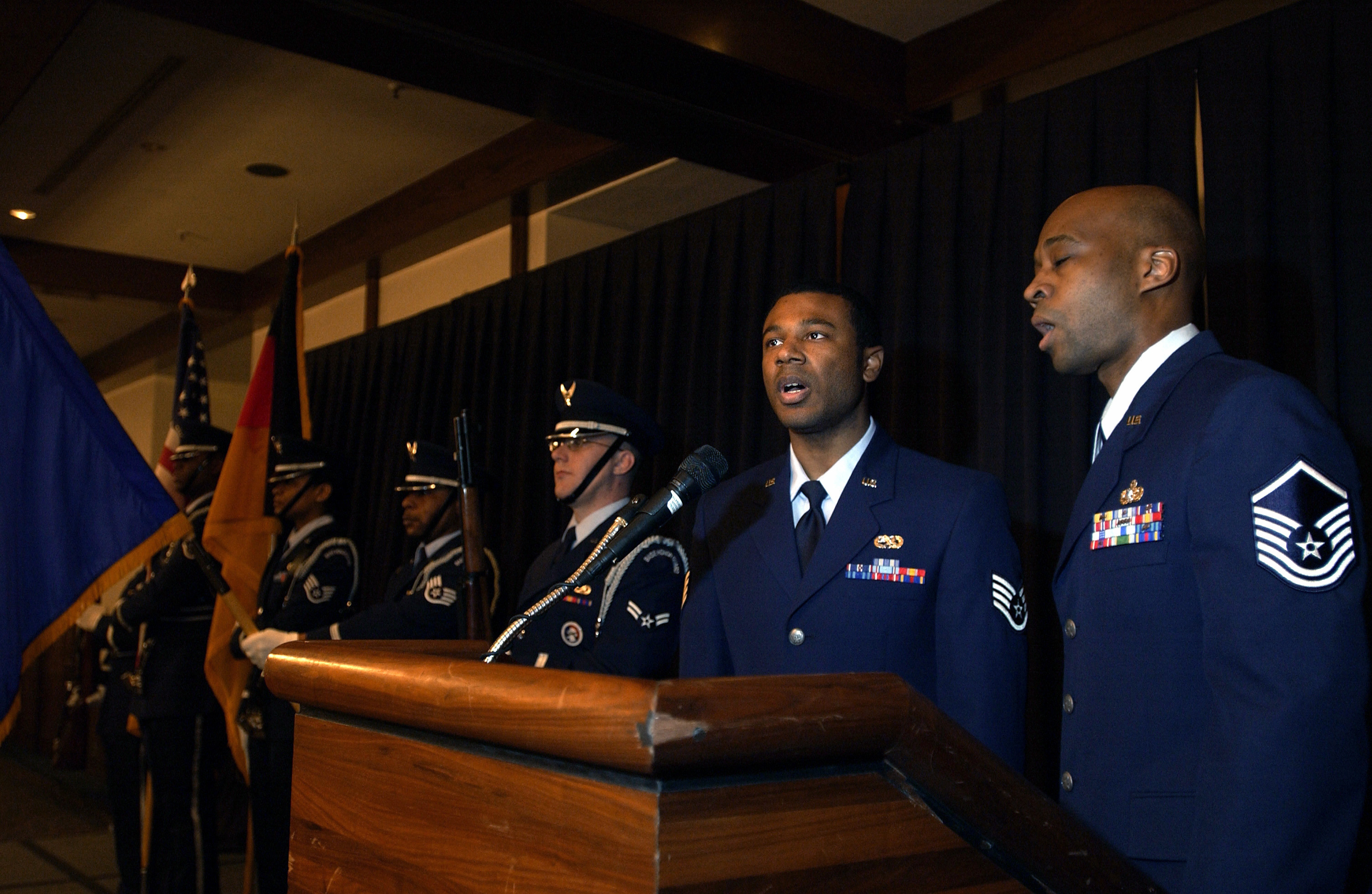 US Air Force (USAF) STAFF Sergeant (SSGT) Brandon Perkins (left) and USAF MASTER Sergeant (MSGT) Edward Shepard sing the American and German national anthems during the Kaiserslautern African-American Heritage Committee luncheon. The Kaiserslautern African-American Heritage Committee luncheon held at the Ramstein Air Base (AB) Officers Club, Germany as part of African-American Heritage Month