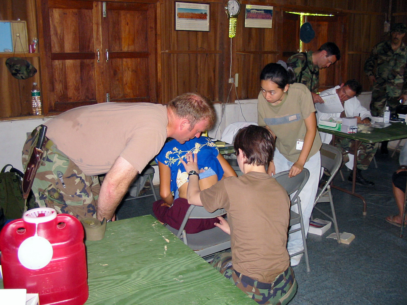 US Army (USA) Medical Doctors assigned to 2nd Battalion, 1ST Special Forces Group (SFG) Airborne, examine a local Thai woman during the Medical Community Assistance Program (MEDCAP) at Ban Dong, Thailand, during Exercise COBRA GOLD 2003