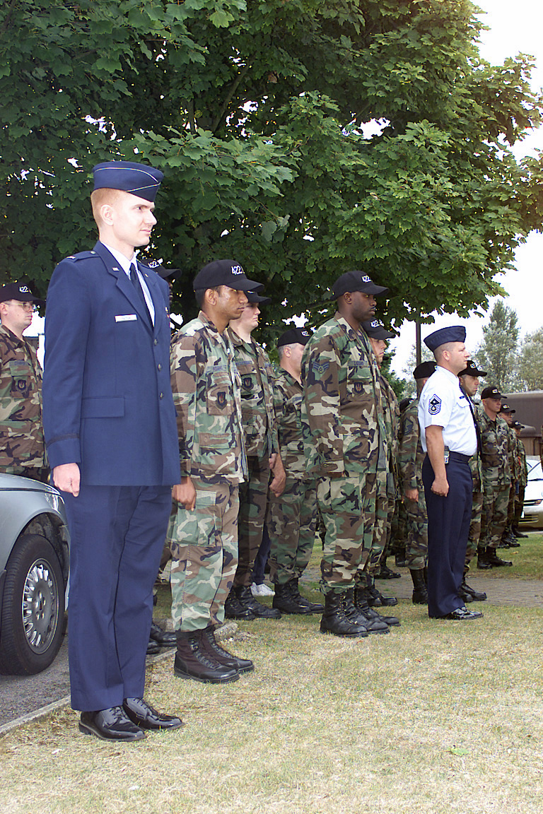 US Air Force (USAF) personnel with the 422nd Air Base Squadron (ABS), Royal Air Force (RAF) Croughton, England (ENG), pay tribute to those who gave the ultimate sacrifice and stand at attention during the playing of the British and American national anthems, part of a Remembrance Ceremony honoring the victims of the terrorist attacks of September 11th, 2001