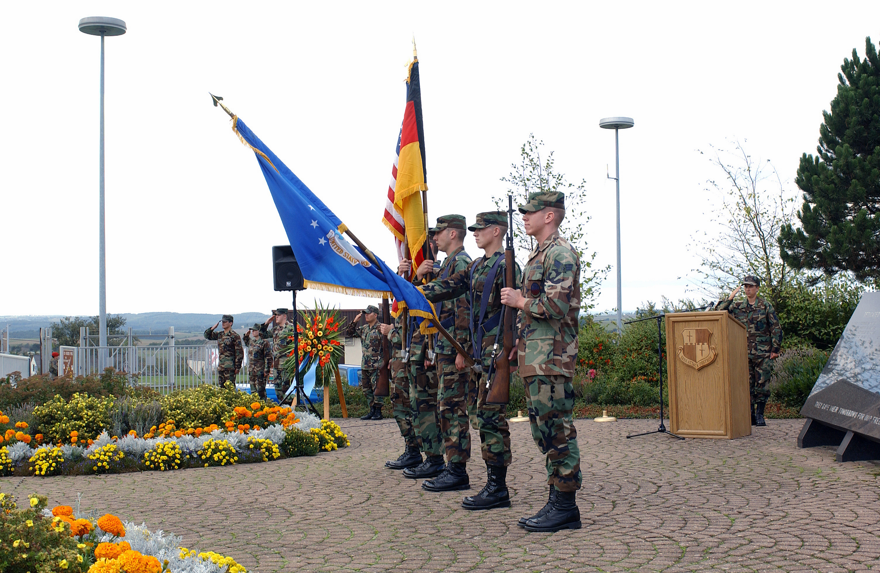US Air Force (USAF) Honor Guard personnel at Spangdahlem Air Base (AB), present arms during the German and American national anthems at a Remembrance Ceremony honoring the victims of the terrorist attacks of September 11th, 2001