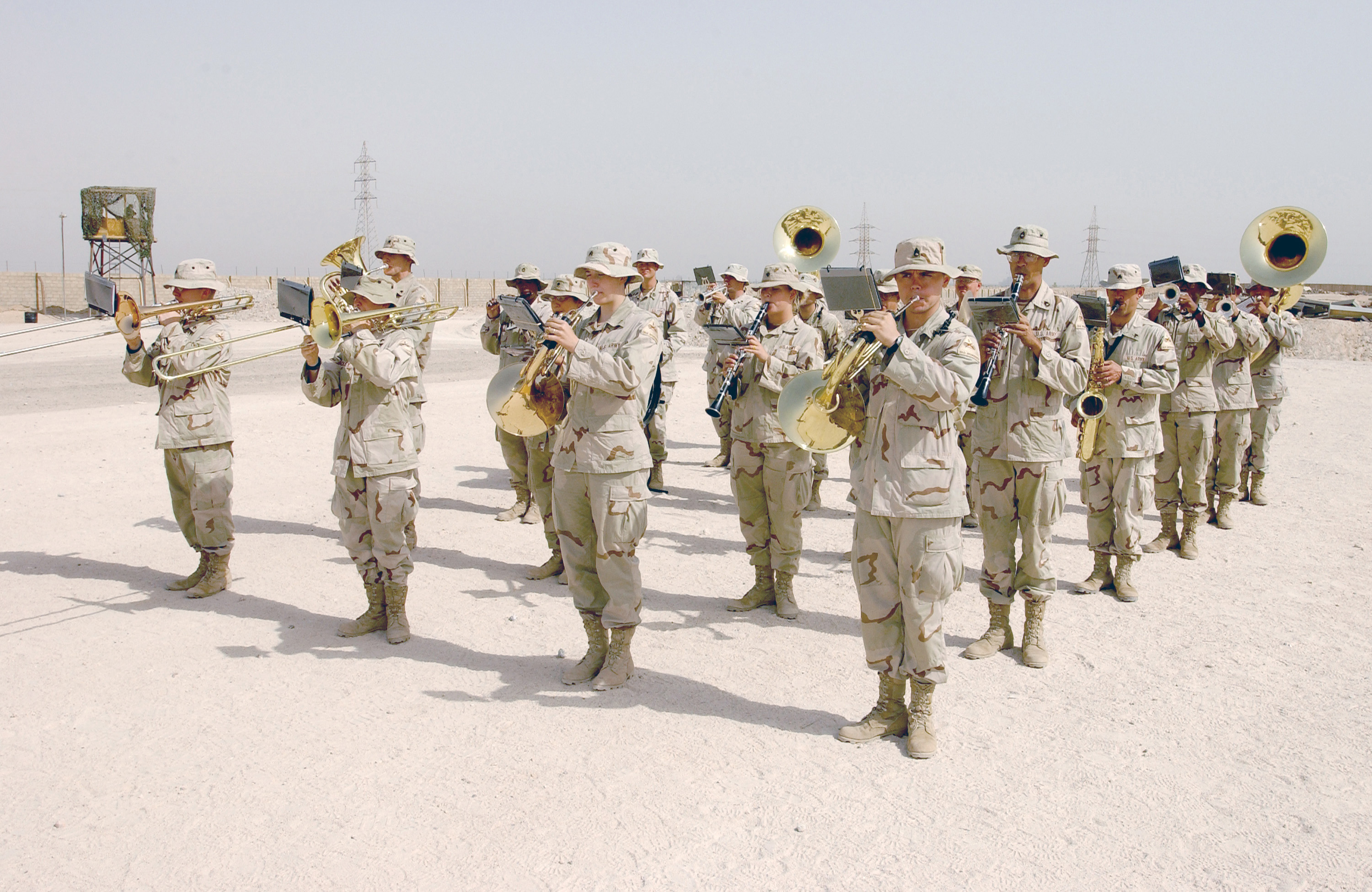 The US Army's (USA) 1ST Armored Division (AD) Band play the Iraqi and US national anthems during a graduation ceremony at the Iraqi Civil Defense Course (ICDC). The ICDC conducted weekly in Baghdad, Iraq, to train new Iraqi recruits on soldier skills and to prepare them to work with coalition forces supporting Operation IRAQI FREEDOM
