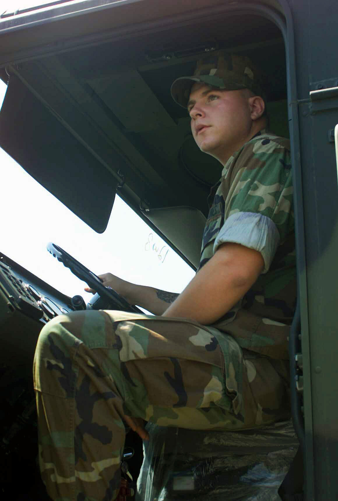 US Marine Corps (USMC) Lance Corporal (LCPL) Michael Ricks, Vehicle Recovery Operator, Headquarters Battalion (HQ BN), Truck Company, 1ST Marine Division (MAR DIV), Marine Corps Base (MCB) Camp Pendleton, California (CA), sits in a Medium Tactical Vehicle Replacement (MTVR) 7-ton transportation truck in the Companys parking lot. The main goal of Truck Company is to ensure all military vehicles coming their way are in proper working order