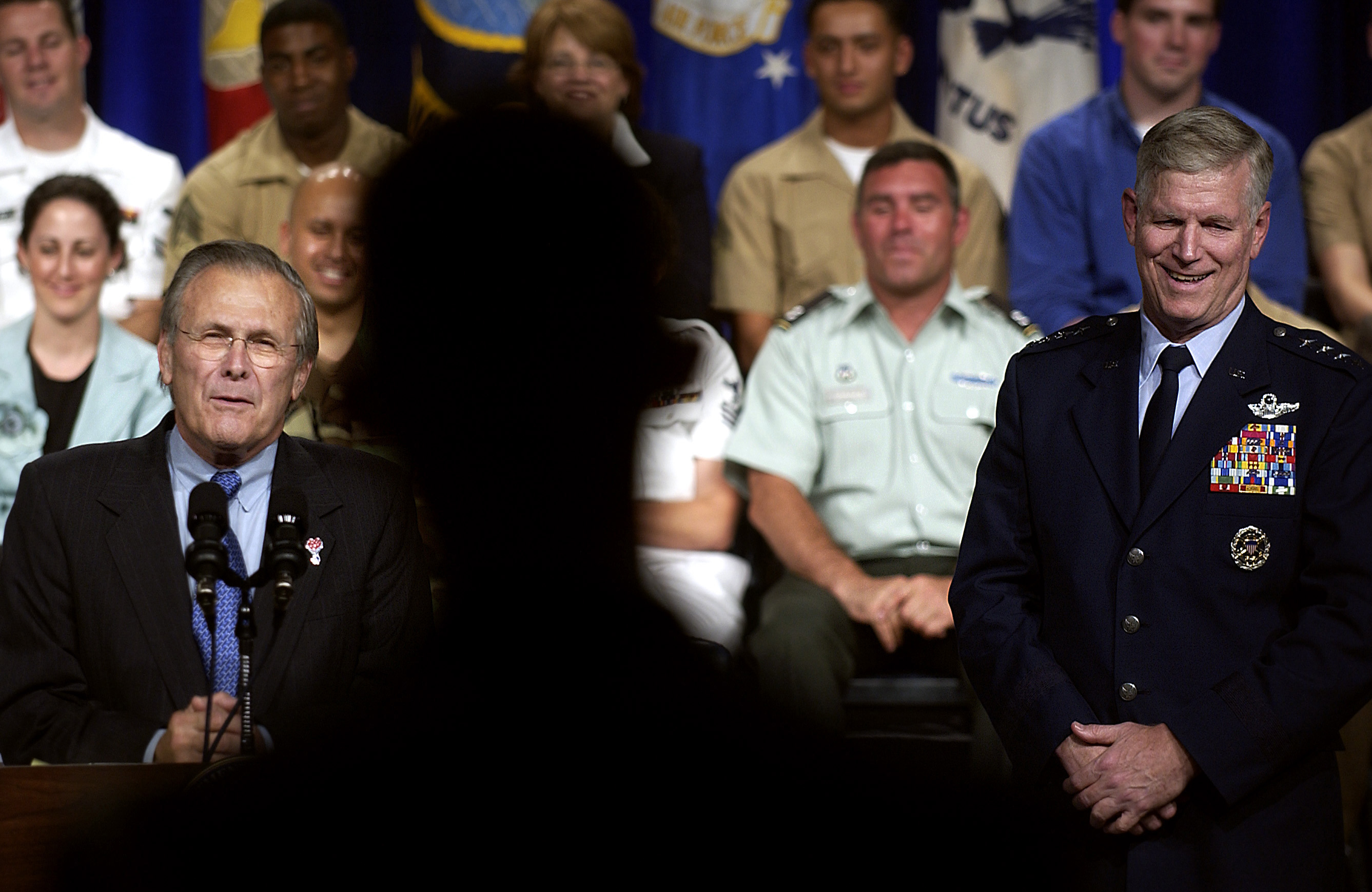 The Honorable Donald H. Rumsfeld, U.S. Secretary of Defense, addresses the audience, as U.S. Air Force GEN. Richard Myers, Chairman of the Joint Chiefs of STAFF, listens, during a worldwide Town Hall meeting at the Pentagon, Washington, D.C., on Jun. 29, 2005. (DoD photo by STAFF SGT. Myles D. Cullen) (Released)