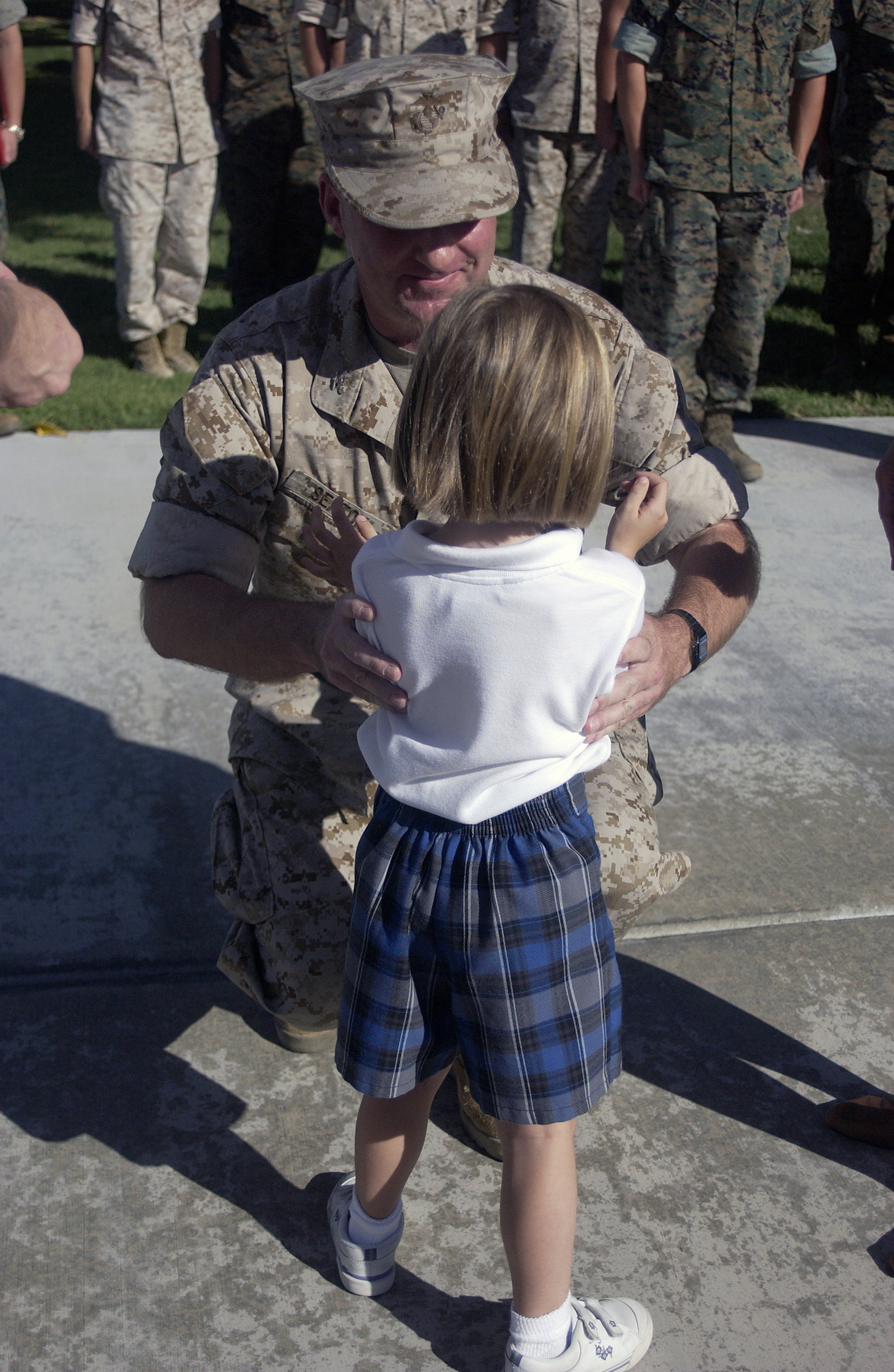 U.S. Marine Corps COL. James B. Seaton gives his daughter, Erin Seaton, a kiss during his promotion ceremony at Marine Corps Air Ground Command Center (MCAGCC), Twentynine Palms, Calif., Sept. 9, 2004. (U.S. Marine Corps photo by Lance CPL. Patrick J. Green) (Released)