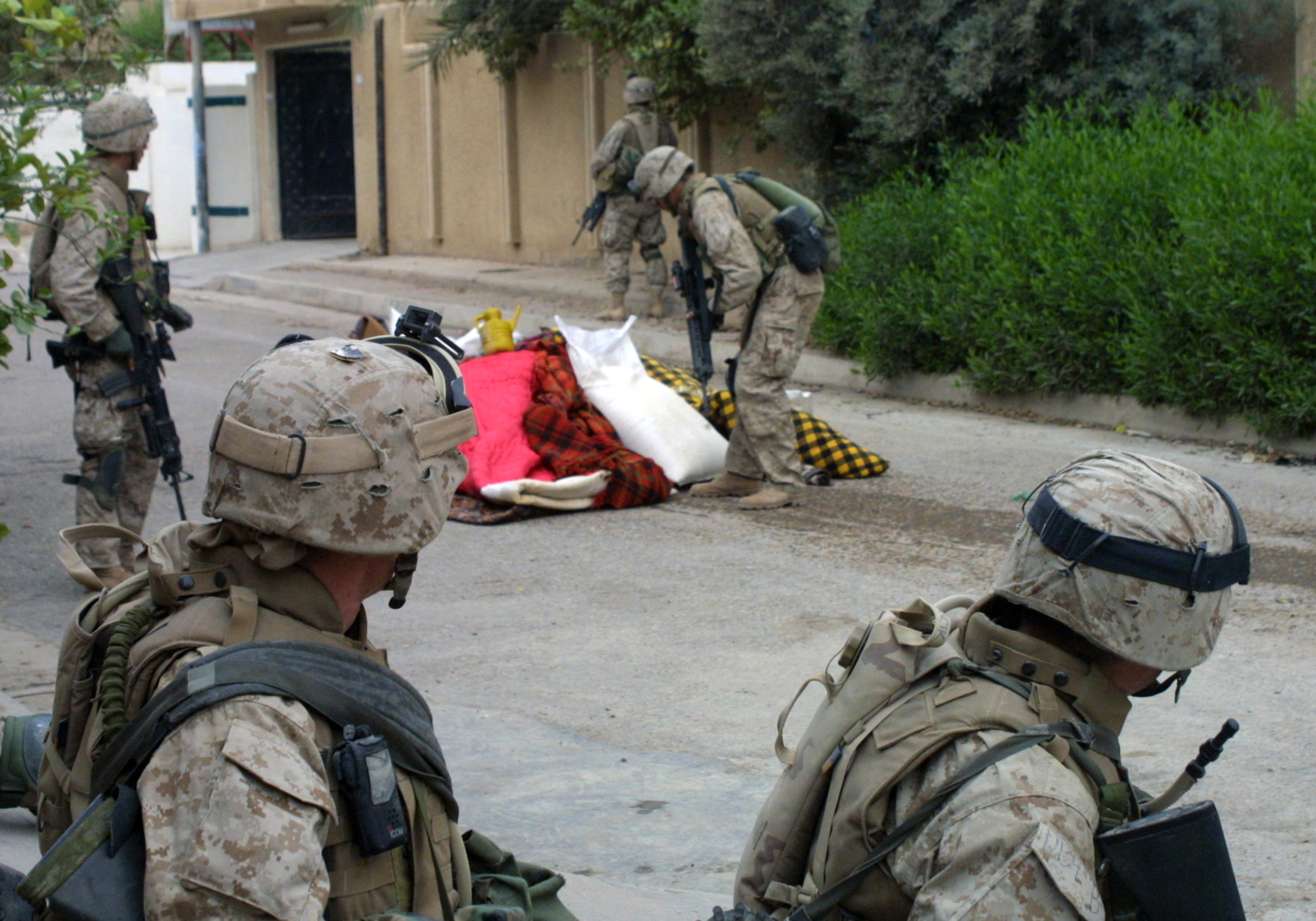 U.S. Marine Corps Bravo Company, 1ST Battalion, 3rd Marine Regiment, Marines collect confiscated bedding for proper disposal that they found in house to house searches in the city of Fallujah, Al Anbar Province, Iraq, on Nov. 17, 2004, during Operation Iraqi Freedom. (U.S. Marine Corps photo by Lance CPL. Jeremy W. Ferguson) (Released)