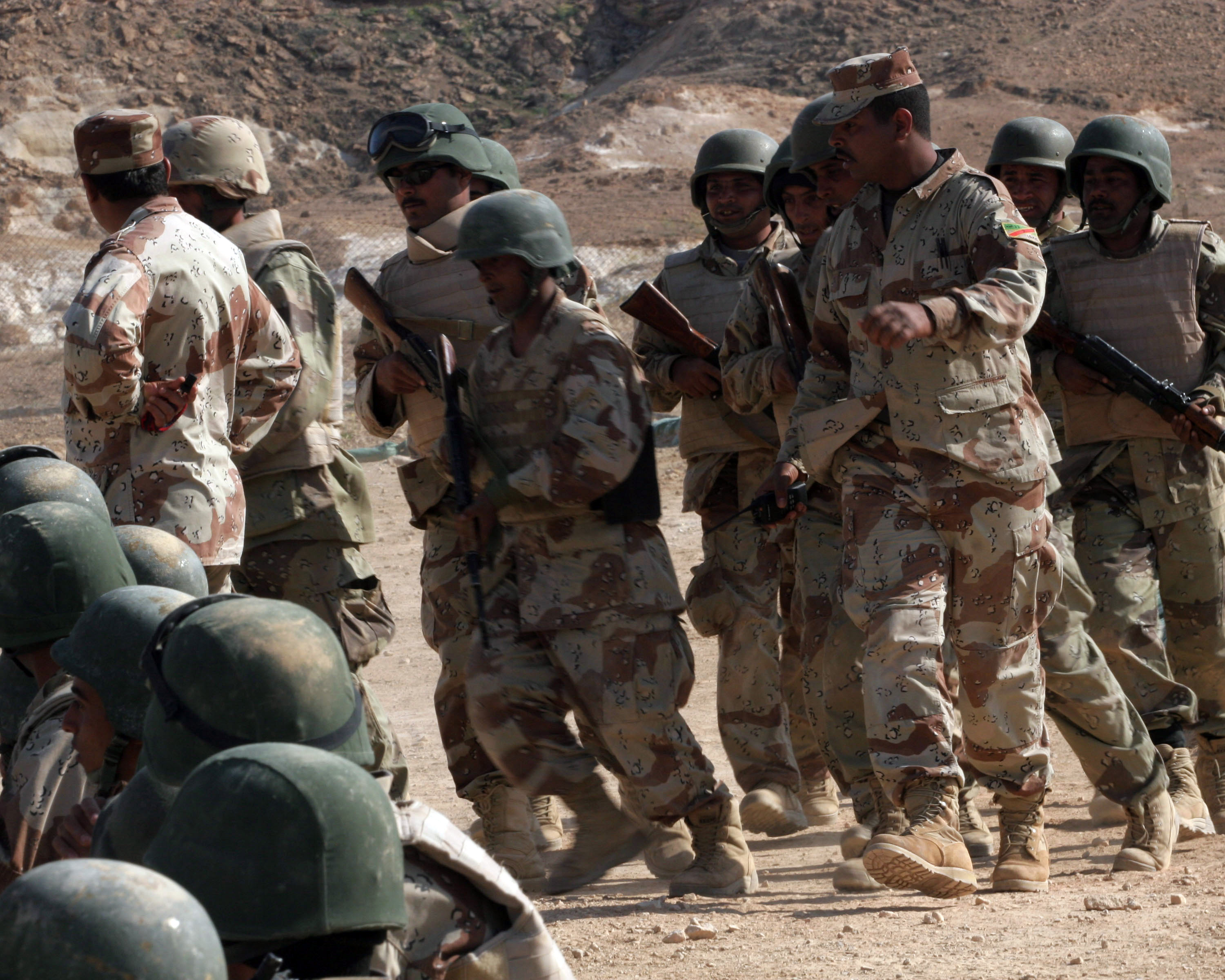 An instructor with the 2nd Briade 7th Iraqi Army Division Military Transition Team (MiTT 2-7) marches Iraqi Army Soldiers in the School of Infantry (SOI) back after an exercise on proper squad patrollin formations on Camp Yasser, Asad Air Base, Iraq on March 20, 2007. SOI is a ten day trainin school that teaches advanced fihtin techniques and tactics to new Iraqi Army Soldiers before they report to their battalions. 2nd Battalion 7th Iraqi Army Division Military Transition Team is deployed as a part of MNF-W in support of Operation Iraqi Freedom in the Anbar province of Iraq to develop the Iraqi Security Forces, facilitate the development of official rule of law throuh democratic...