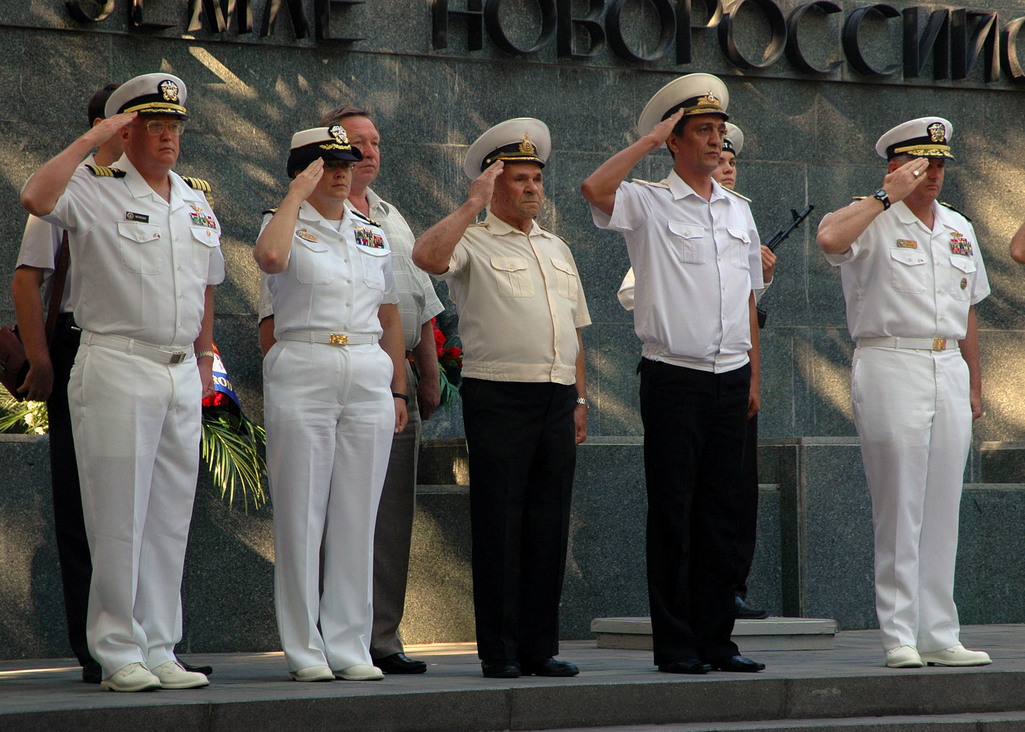 U.S. Navy Rear Adm. Phil Greene, far right, Commander Navy Europe, Policy, Resources and Strategy, and Russian Navy Rear Adm. Sergei Menyalo, second from right, Naval District Commander, render salute during the playing of the national anthems of Russia and the U.S. following a wreath laying ceremony at Novorossiysk, Russia, on Sept. 8, 2006. The 90-minute ceremony was held in memory of Russian soldiers who liberated the city from German occupation during World War II. (U.S. Navy photo by Mass Communication SPECIALIST 2nd Class Michael Lavender) (Released)