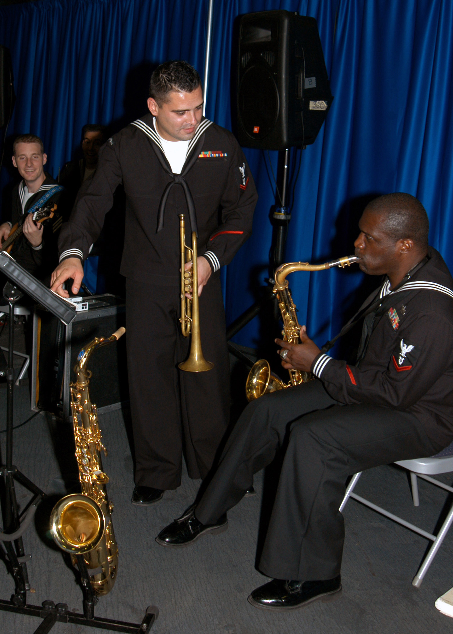 Members of the U.S. 6th Fleet Navy Band practice playing the Cyprus and U.S. national anthems before a reception onboard Nimitz Class Aircraft Carrier USS DWIGHT D. EISENHOWER (CVN 69) during their three-day port visit at Limassol, Cyprus on Oct. 26, 2006. EISENHOWER is currently deployed in support of maritime security operations in the region. (U.S. Navy photo by Mass Communication SPECIALIST SEAMAN Karisha A. Walker) (Released)